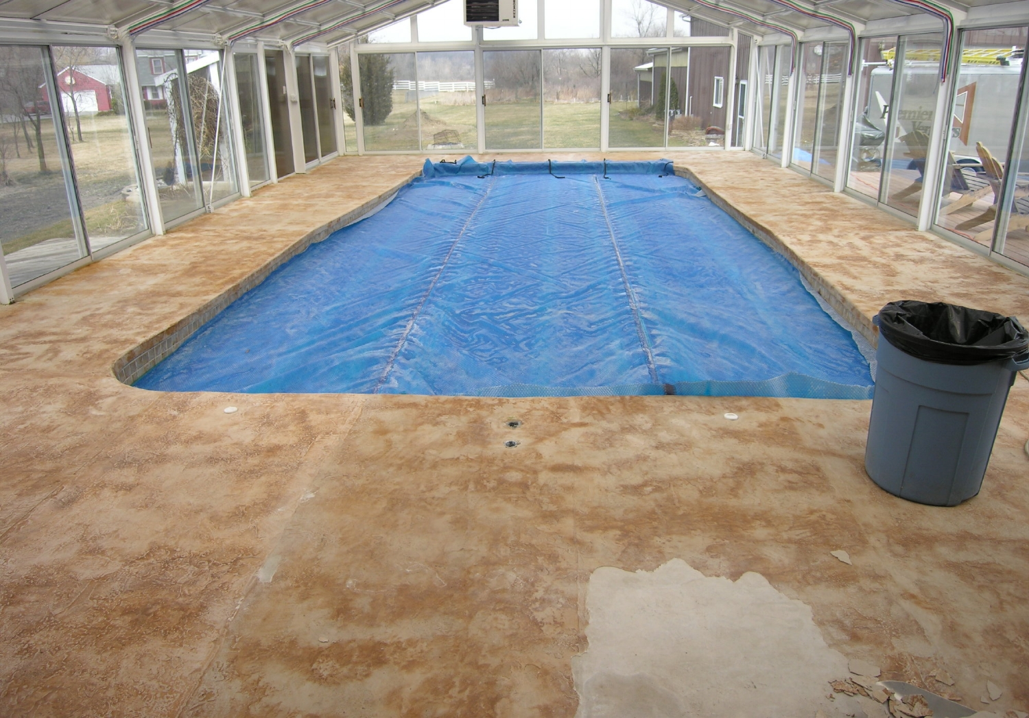 Failed Decorative Cement Overlay Of Indoor Concrete Pool Deck