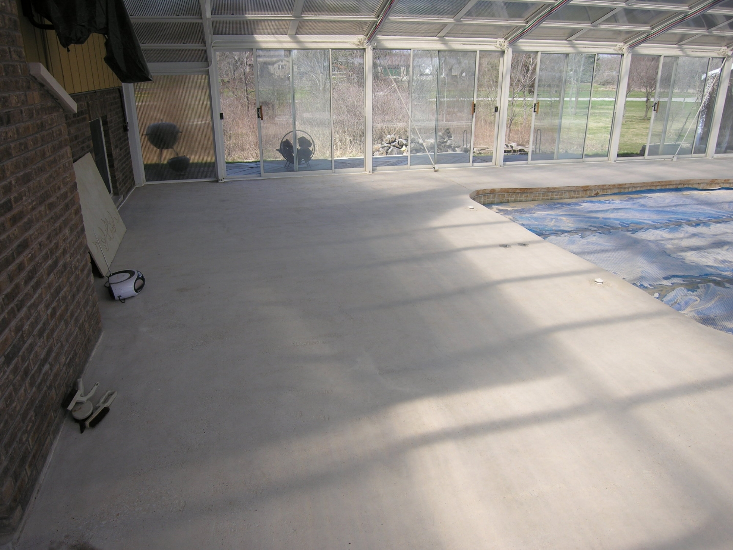 Indoor Concrete Pool Deck After Removing Failed Decorative Cement Overlay With Scarifier And Diamond Grinder