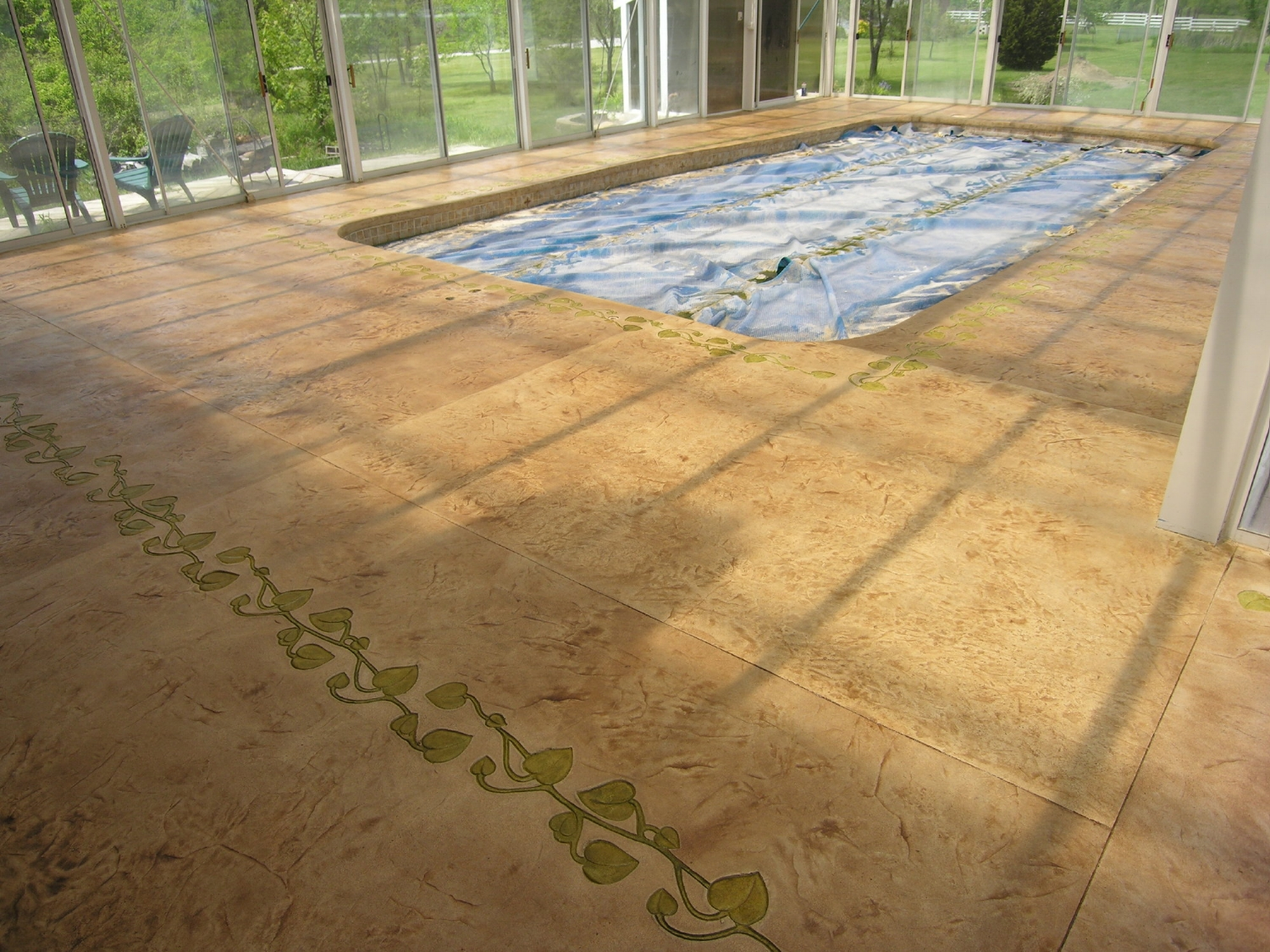 Stamped, Acid-Stained Decorative Cement Overlay Of Indoor Concrete Pool Deck