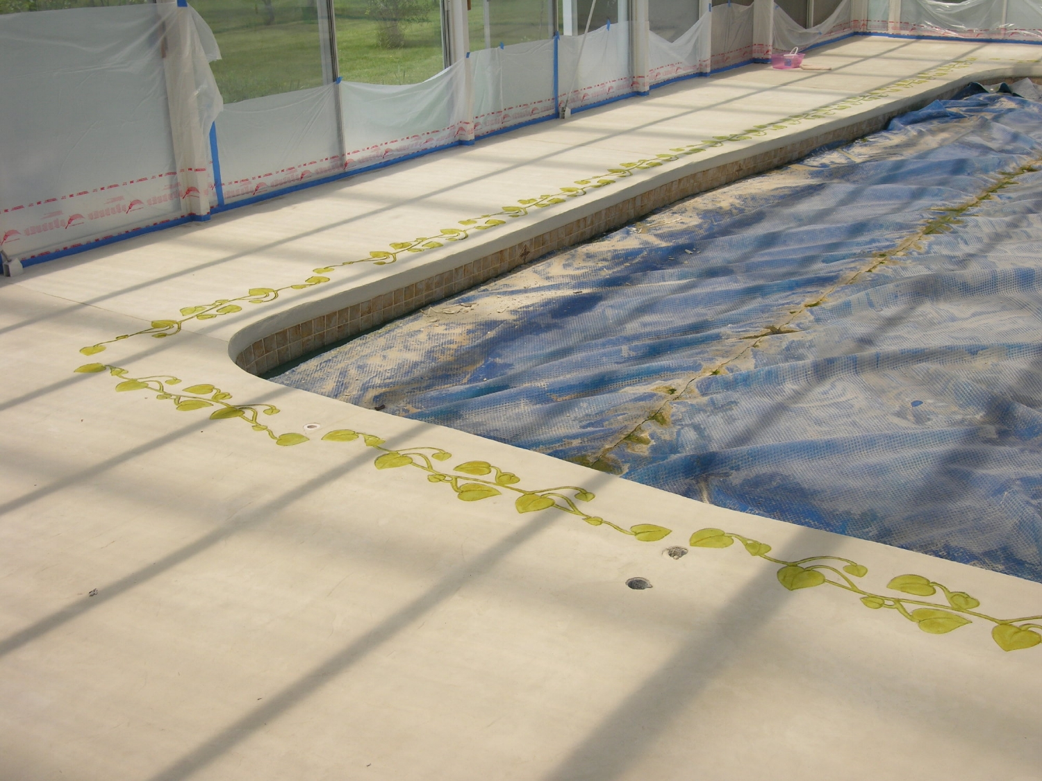 White Cement Overlay Of Indoor Concrete Pool Deck During Acid-Staining Of Decorative, Stamped Border