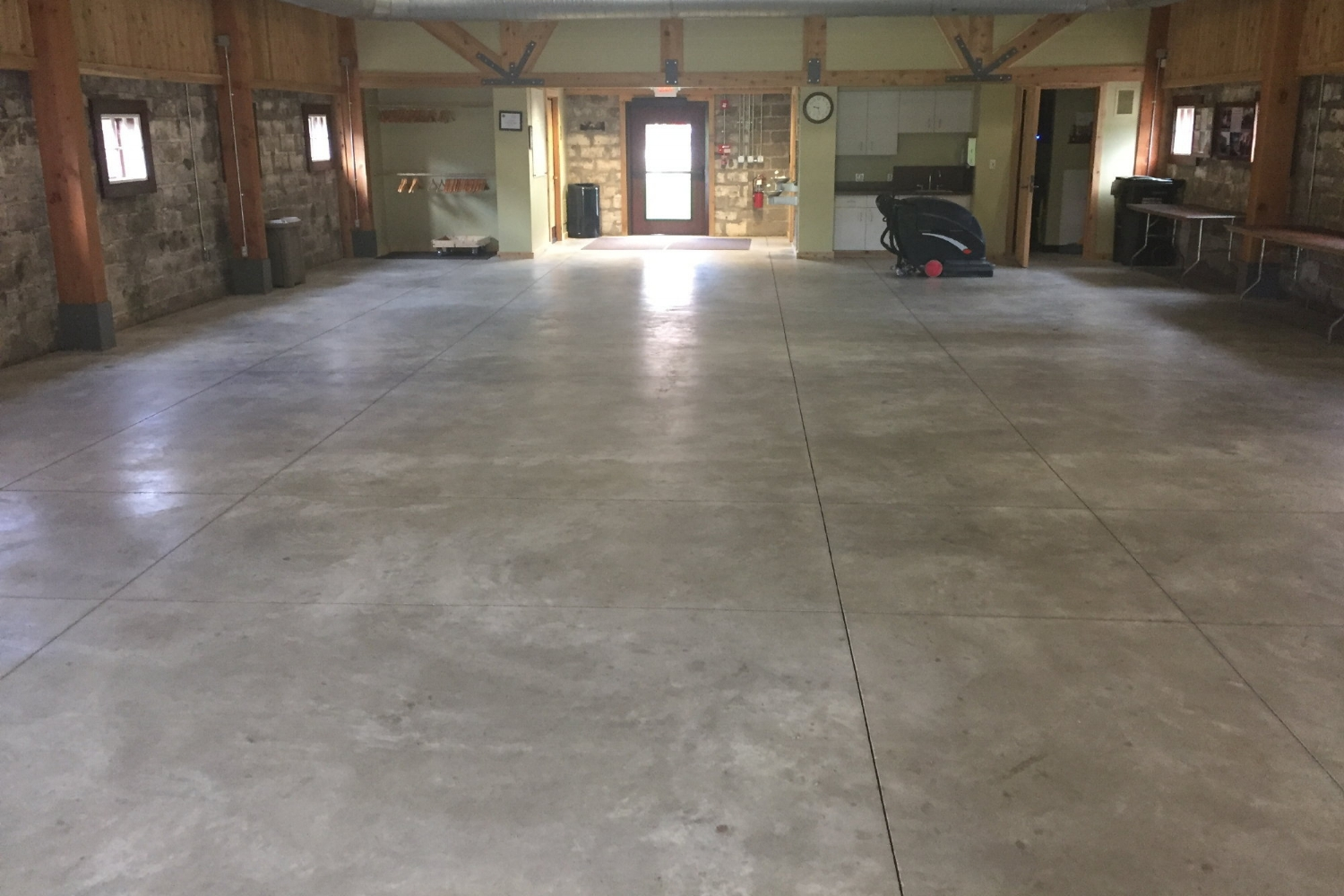Unsealed, Discolored Museum Concrete Floor Before Cleaning And Sealing