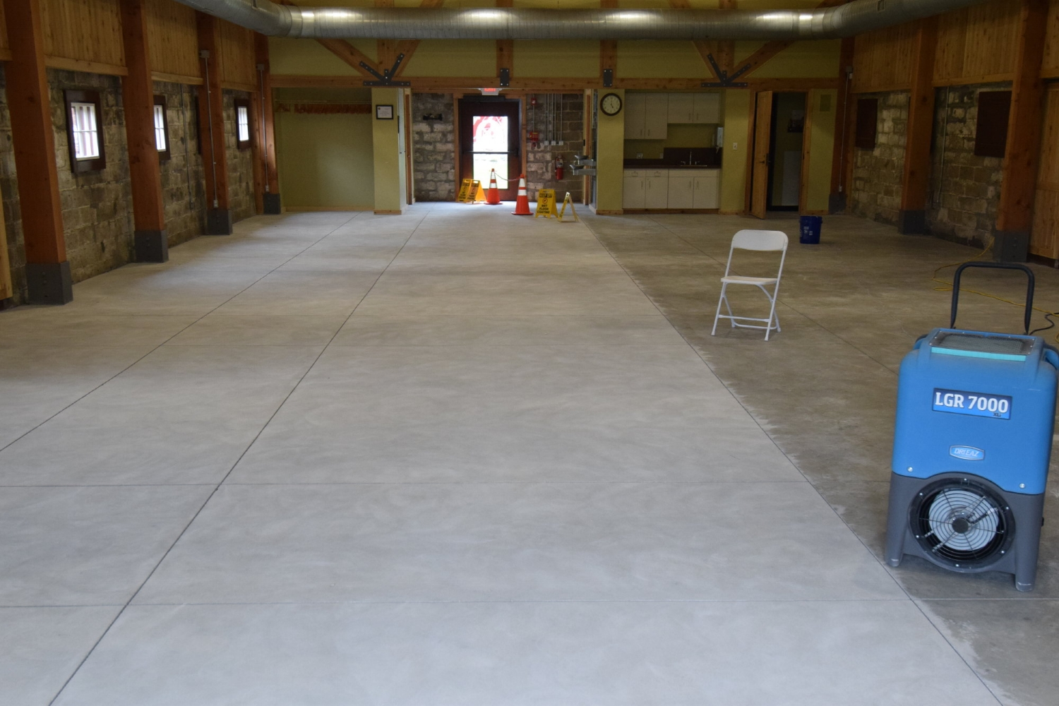 Museum Concrete Floor Being Diamond Ground In Preparation For Clear Sealer