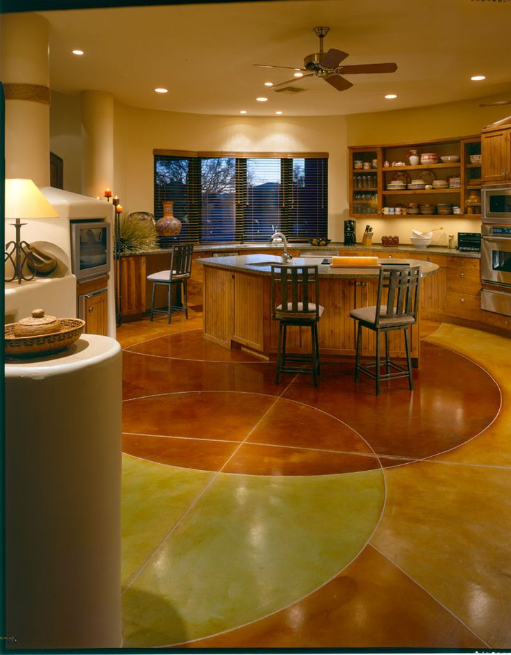 Acid-stained, designer concrete flooring, on the main floor of a custom home, using a self-leveling overlay.  This floor was installed by an Ardex-certified contractor.
