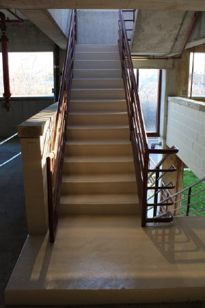 A high performance colored coating system from the Ameron Corporation, owned by PPG, was used on this parking deck stairwell in Troy, MI.