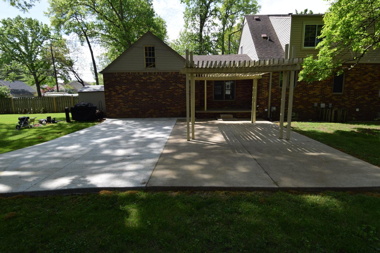 Concrete Patio Combining Two Separate Pours Decades Apart