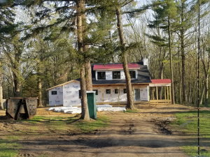 New two-story home being built on a beautiful wooded lot near Saugatuck, Michigan.  The owners decided on decorative concrete flooring for the main level and consulted us about the best system.