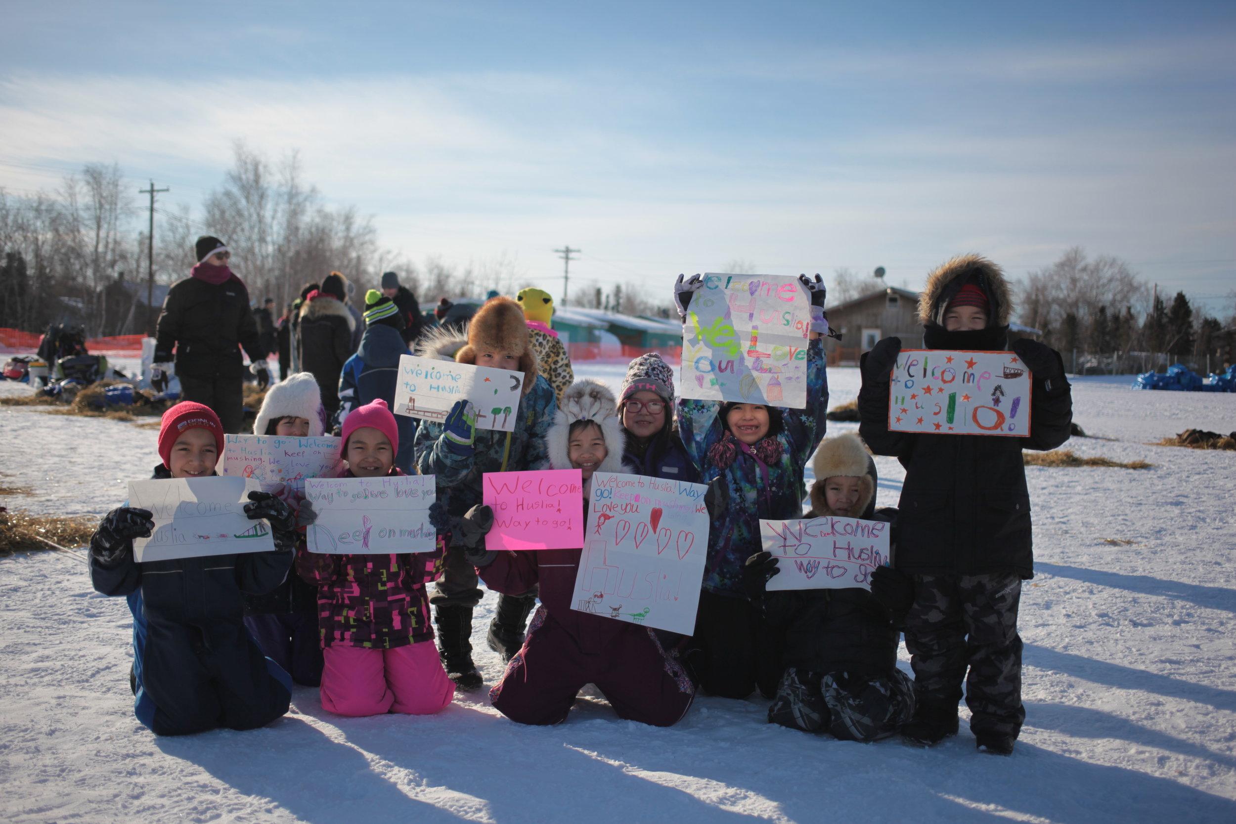 Huslia students welcome Iditarod Racers to Huslia Checkpoint, March 2017