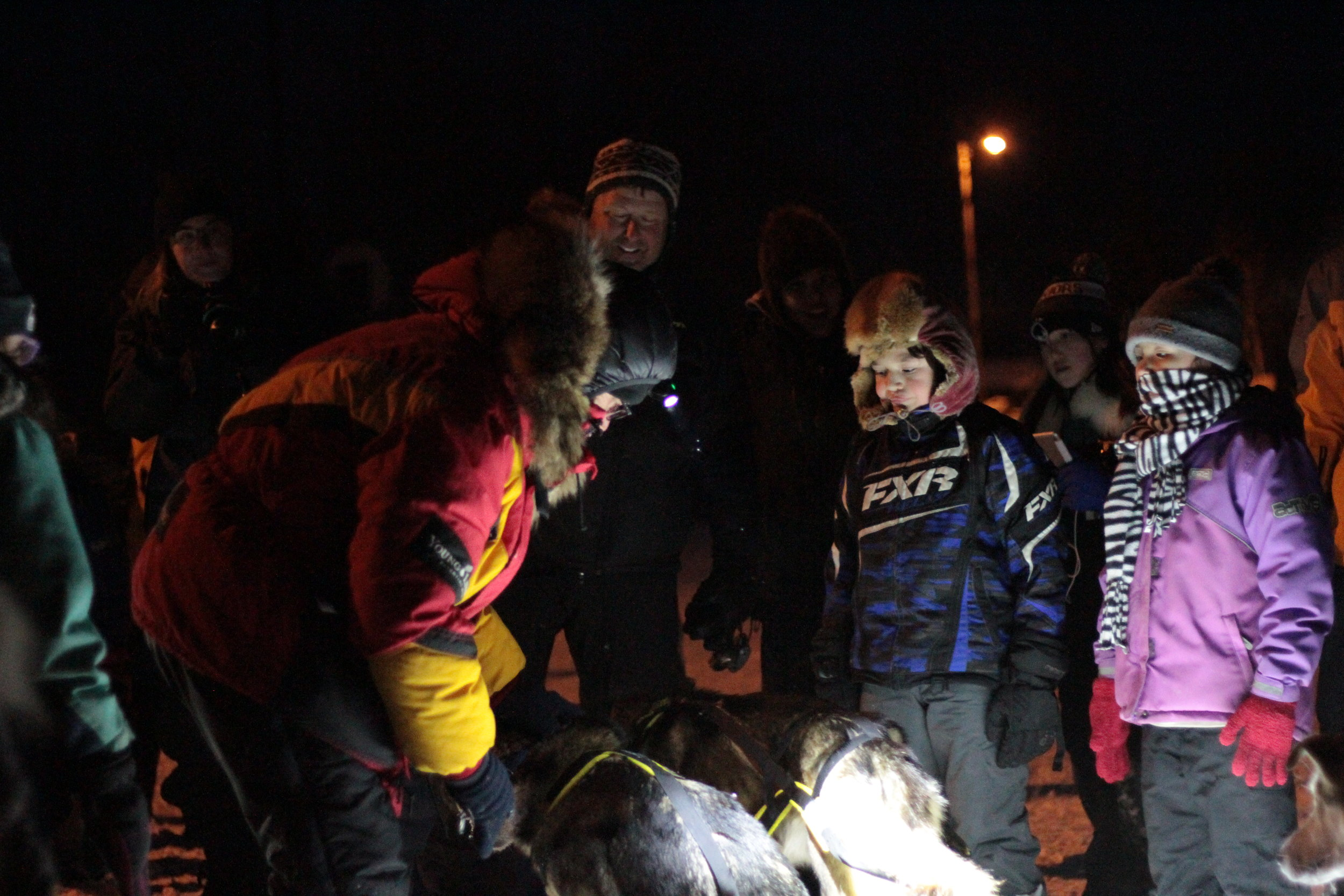 Huslia students talk with Iditarod Racers while stopping at this Checkpoint, March 2017
