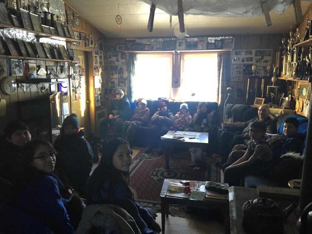 Huslia Junior HS students listening to Musher Wilson Sam telling stories.