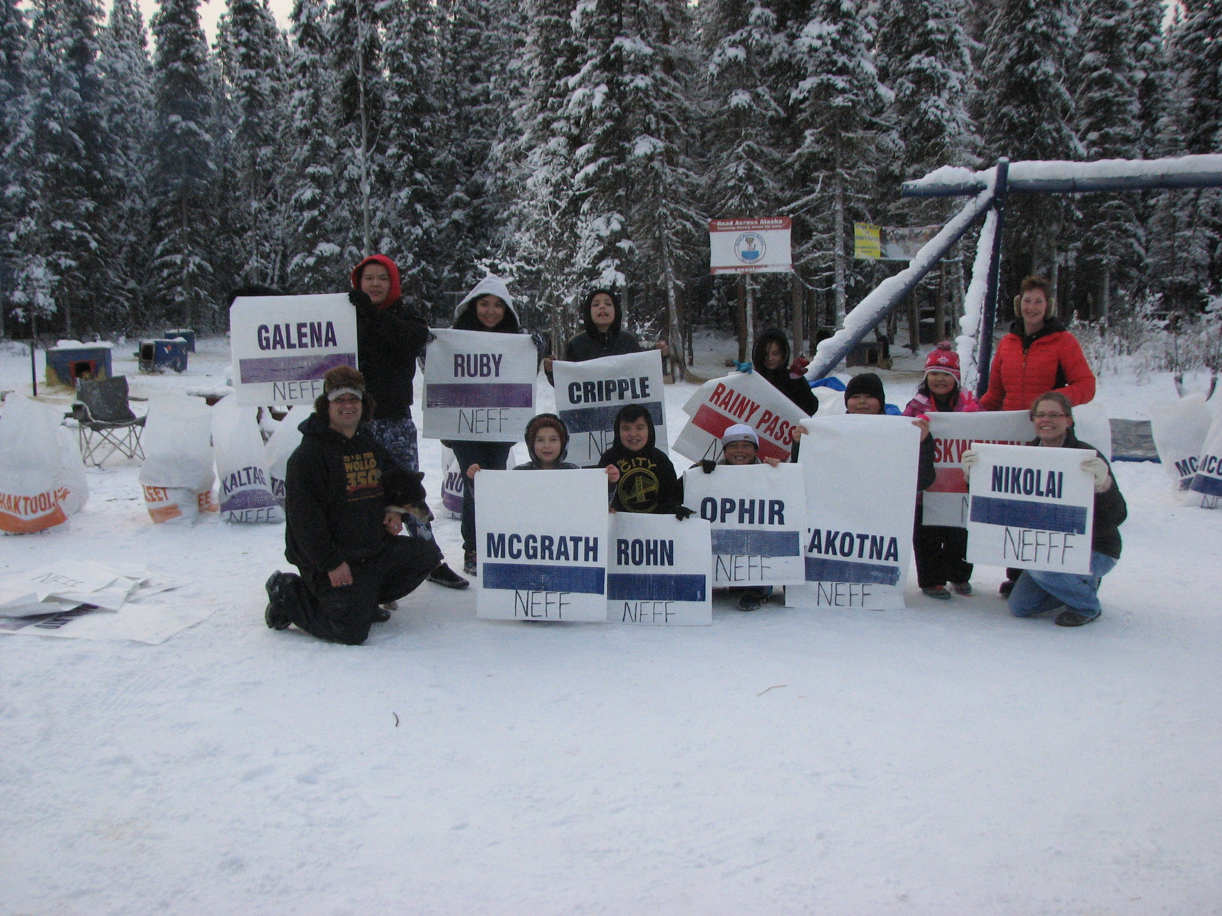 Tanacross students with Musher Hugh Neff and his Iditarod checkpoint bags.