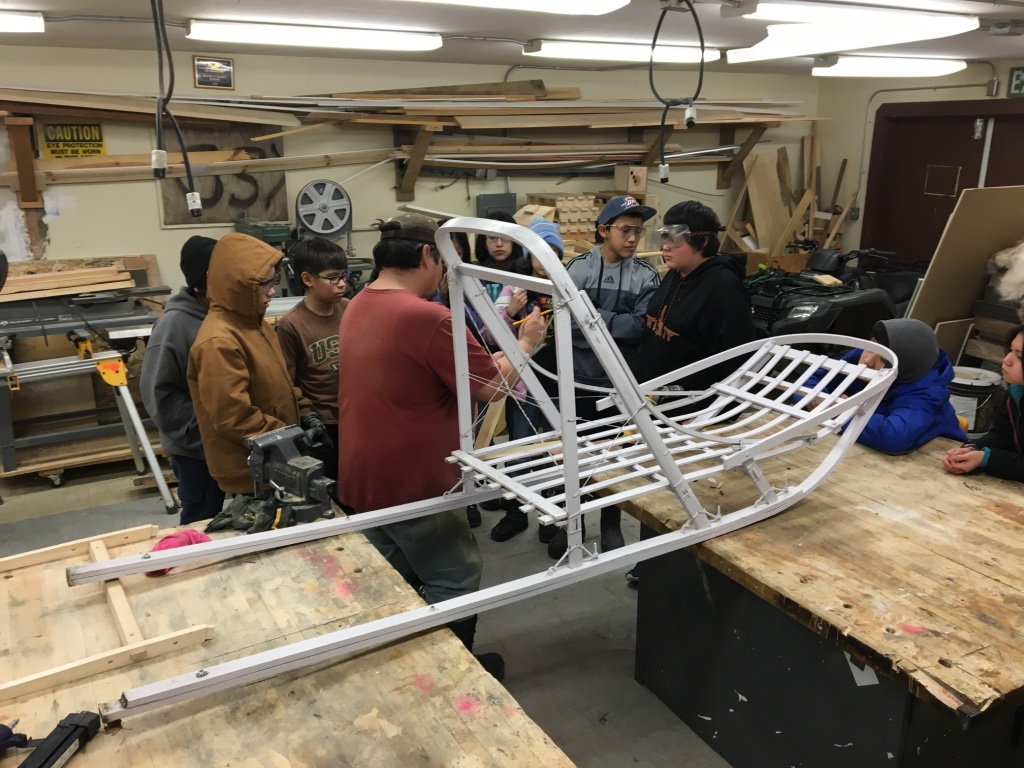 Huslia JHS students learn about sled measurements from Wes Henry.
