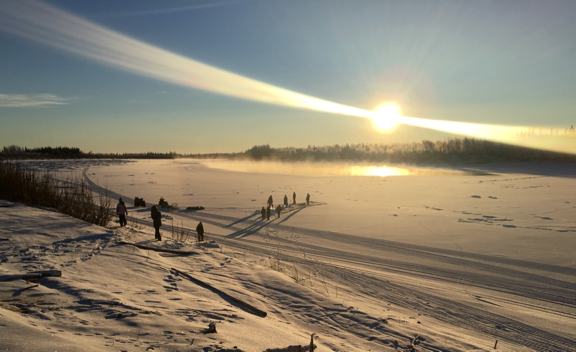 Huslia JHS students learn to set fish net in ice of the Koyukuk River.