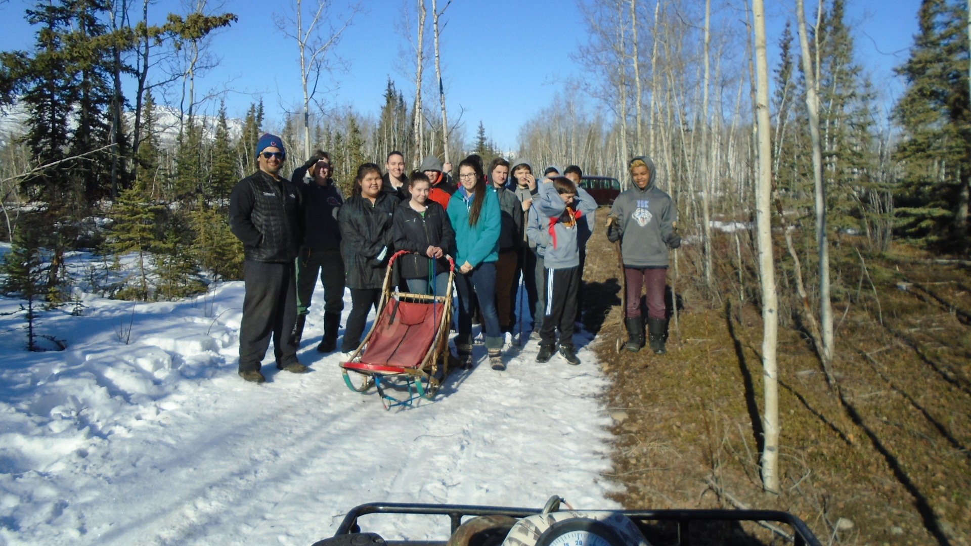 Tok School students ready to ride sled with Hugh Neff's dogs.