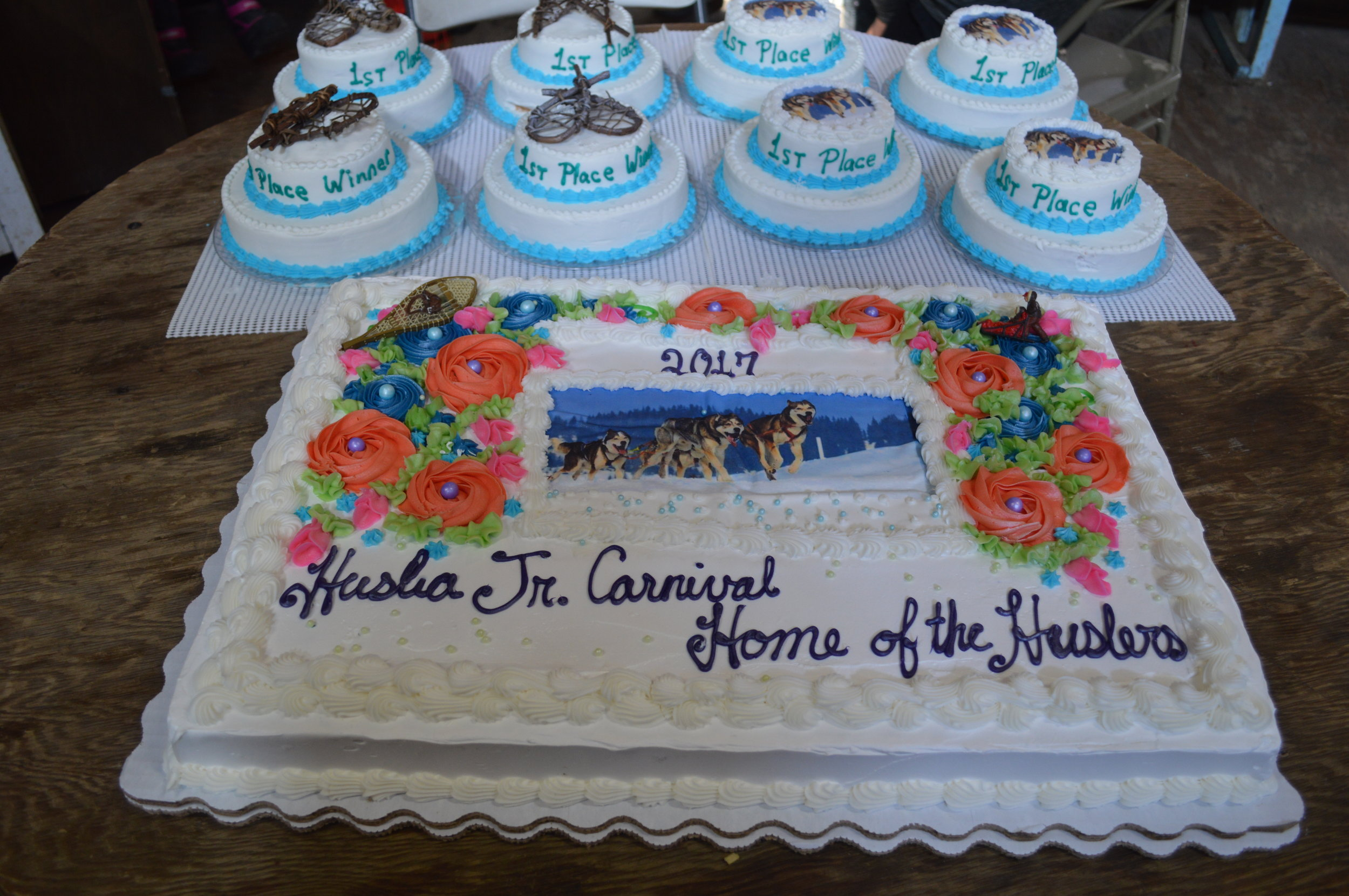 Huslia Jr. Carnival - Community Cake and cakes for 1st Place competition winners .