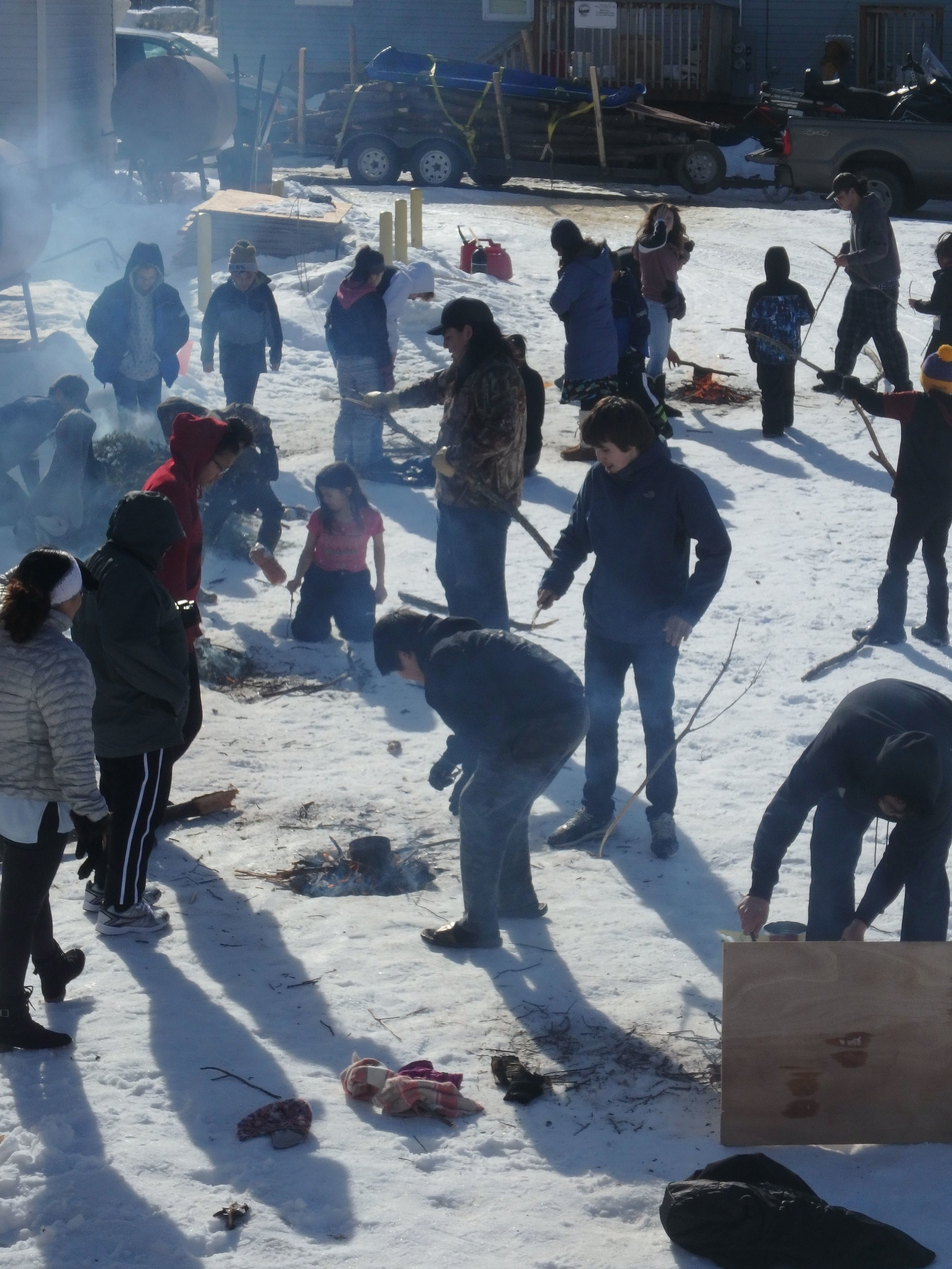 Minto Spring Carnival students learn to brew tea in snow pit.