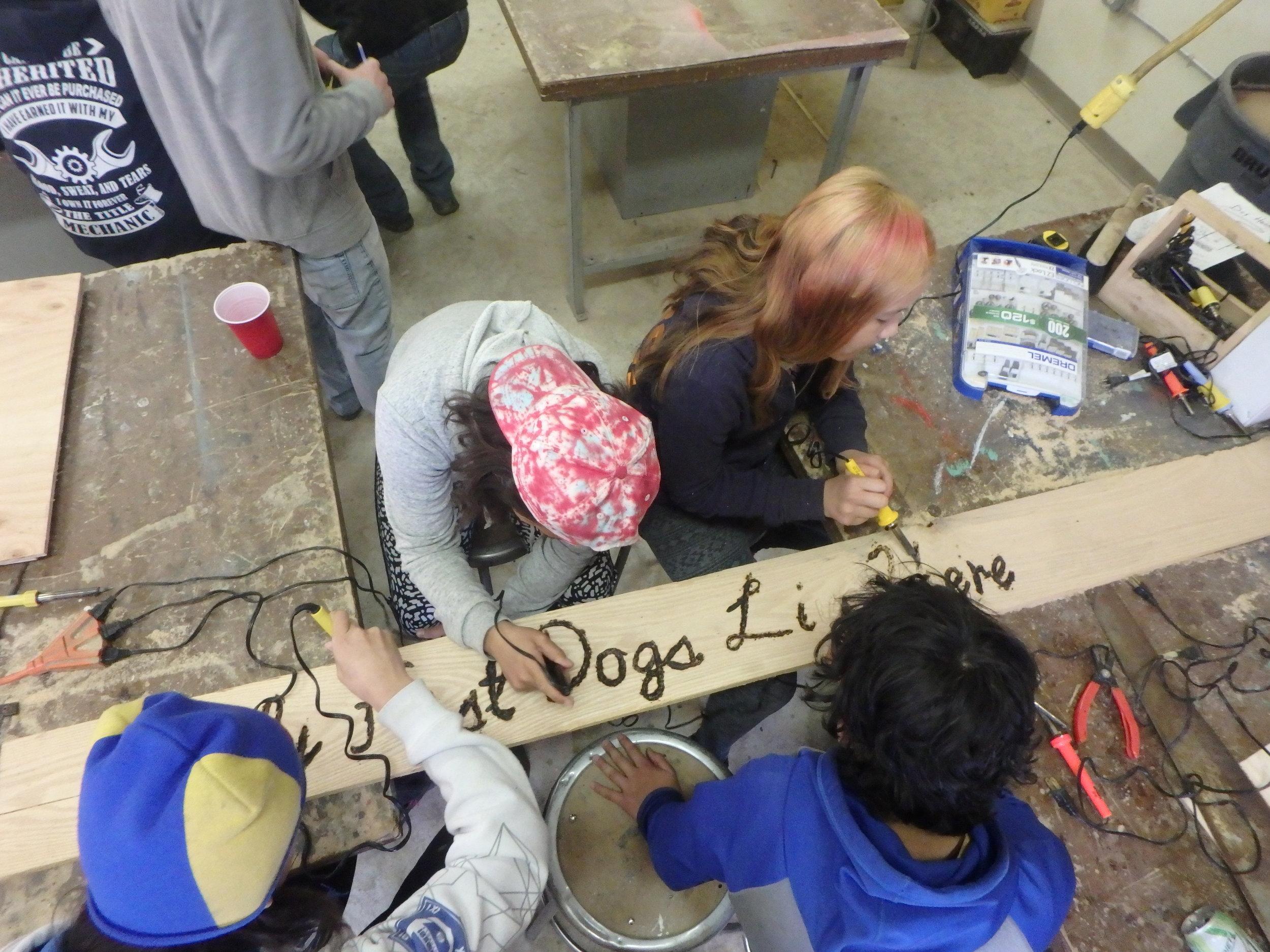 Minto Spring Carnival students work together to make kennel sign.
