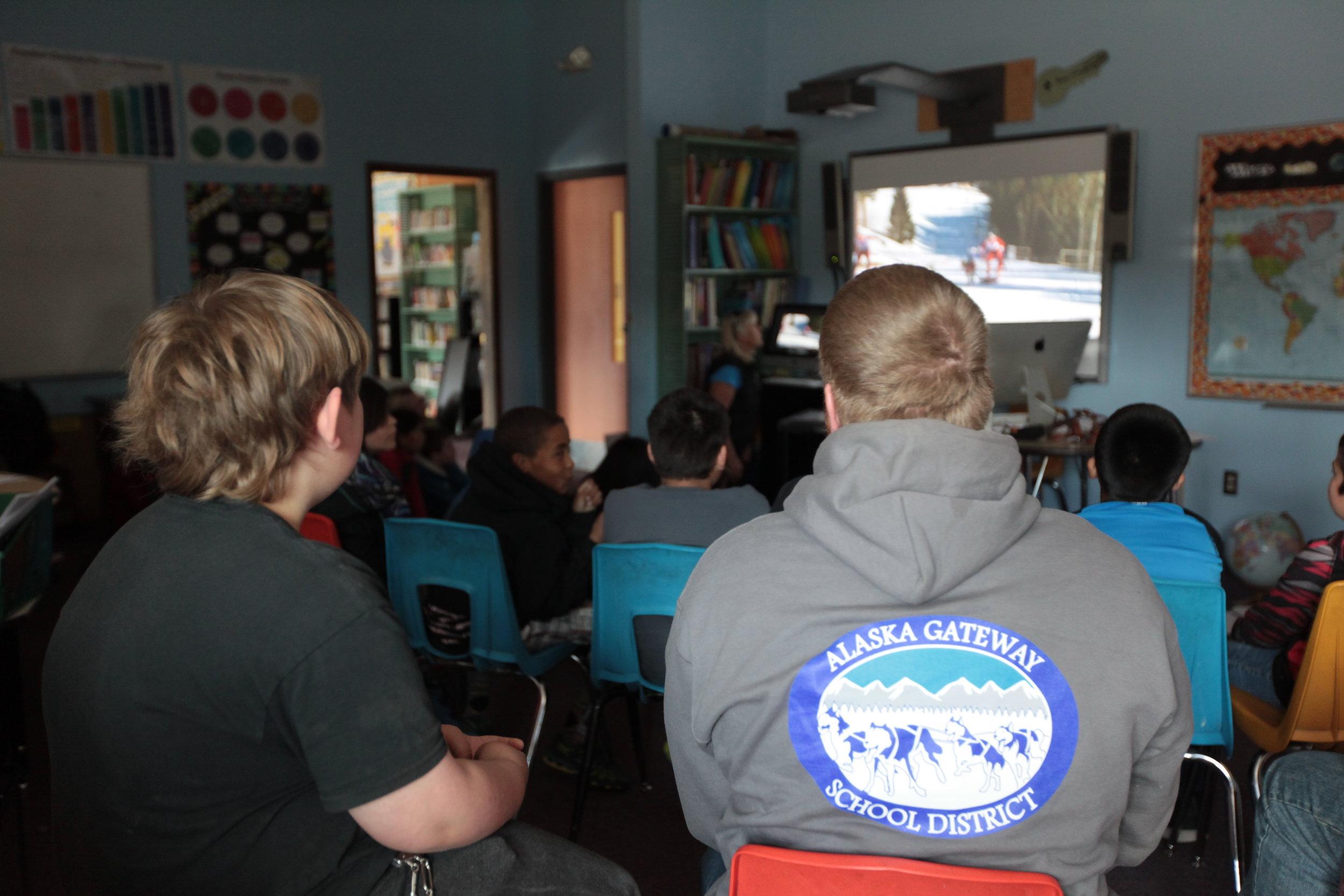 Eagle & Tanacross students listen to Quest guest speaker in classroom.