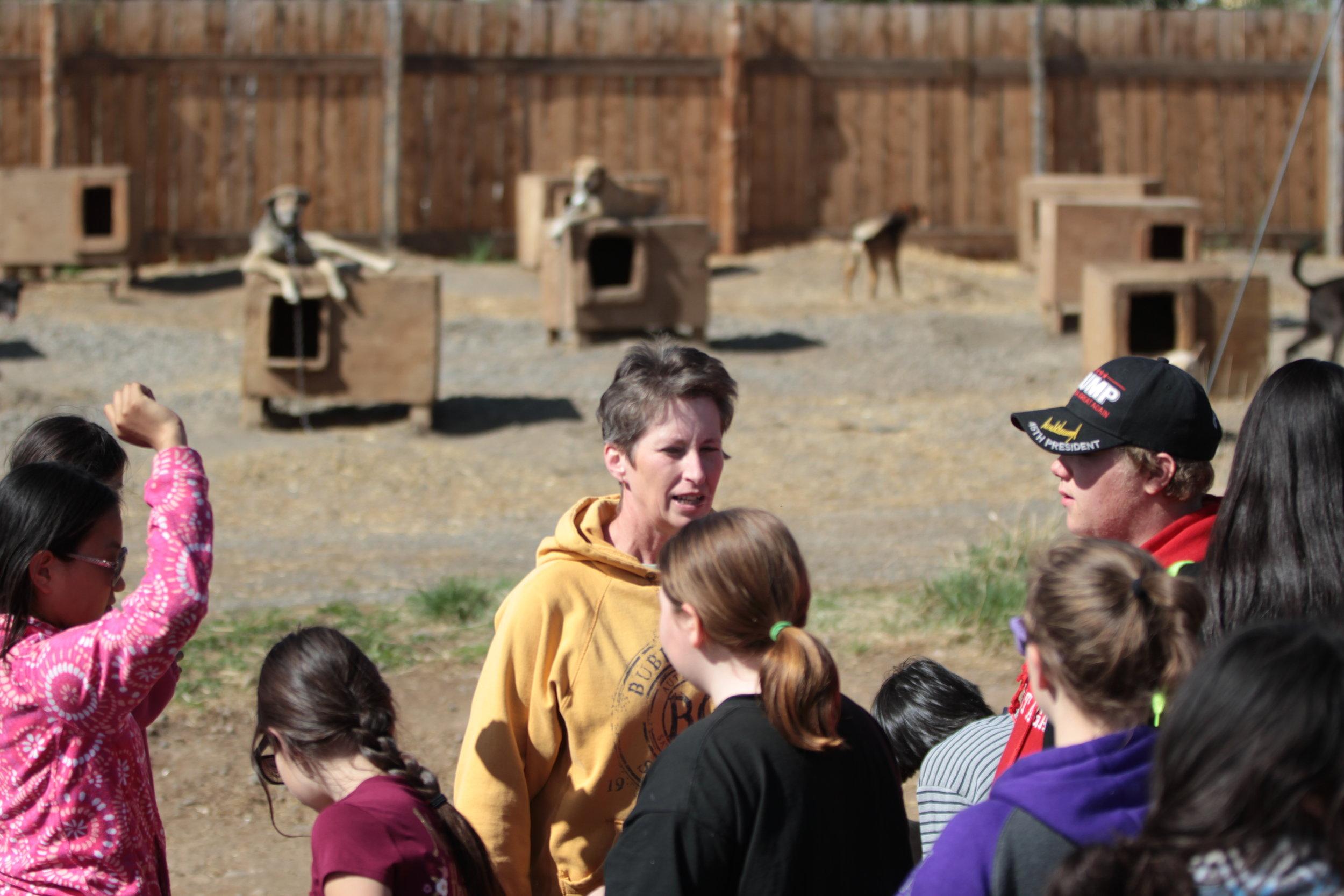 Eagle & Tanacross students in dog yard with Musher Teacher.