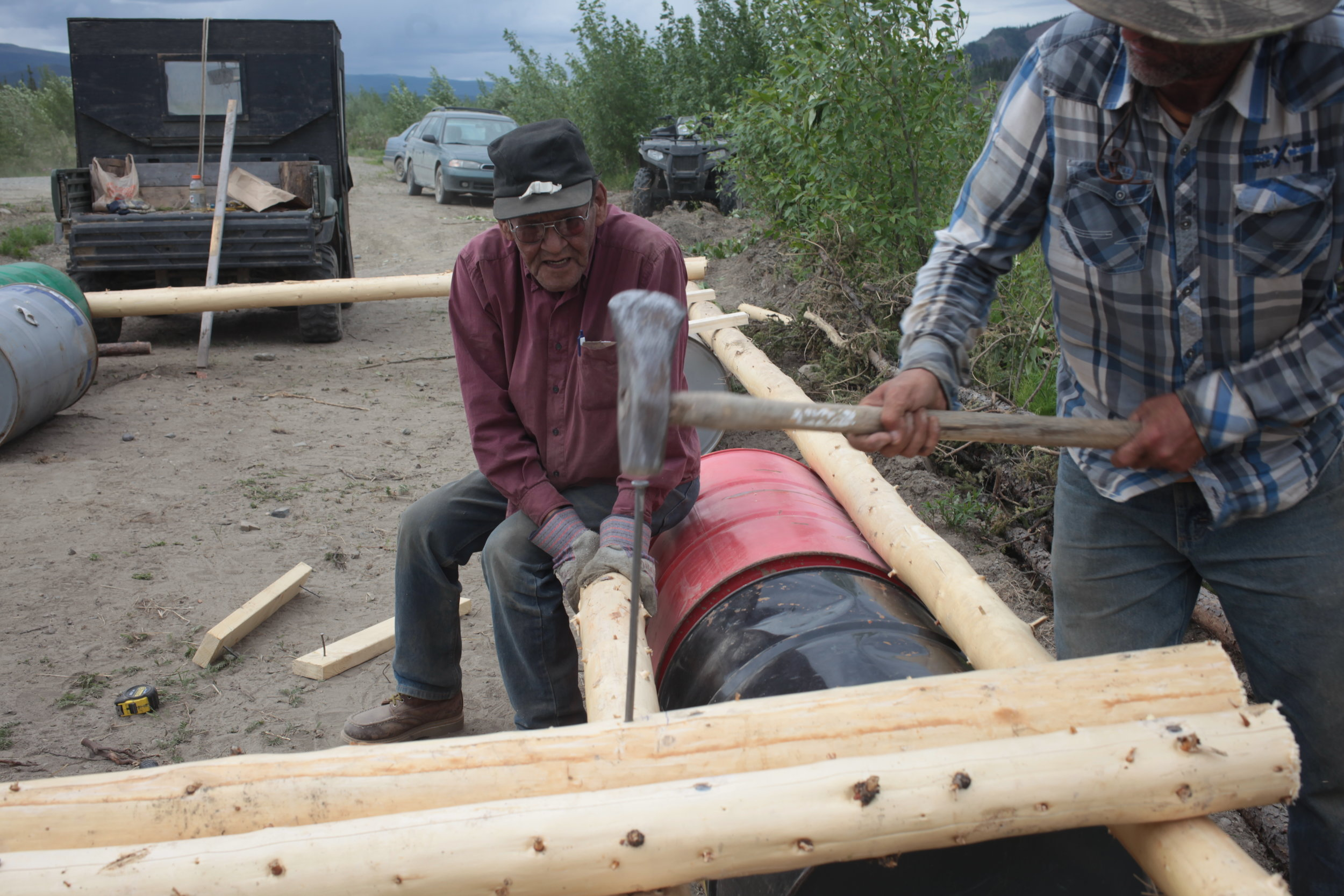 Eagle Fish Wheel Project - Local Culture Experts hammer stake for floater base.