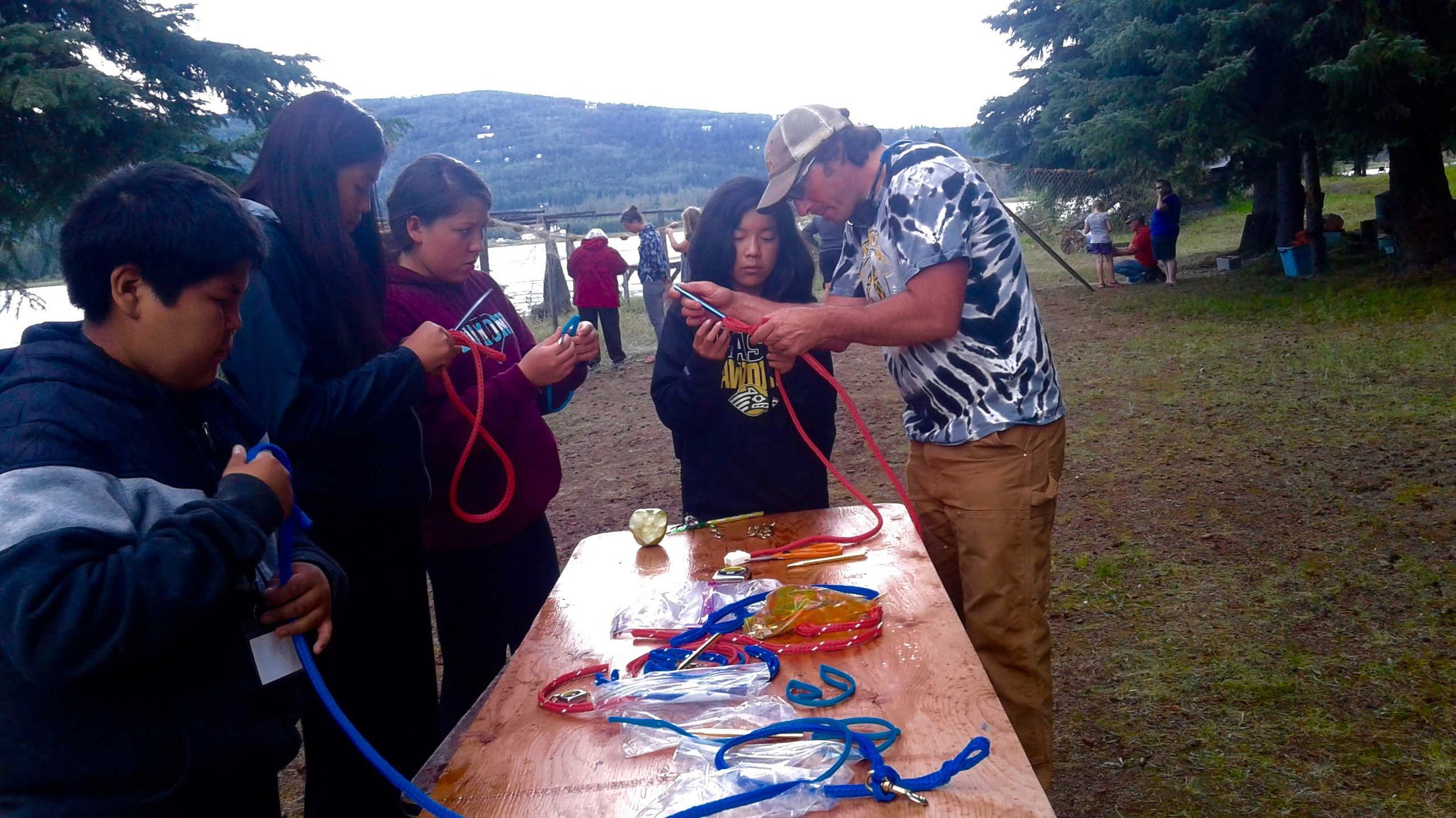 Dog musher teacher shows students how to make lines.