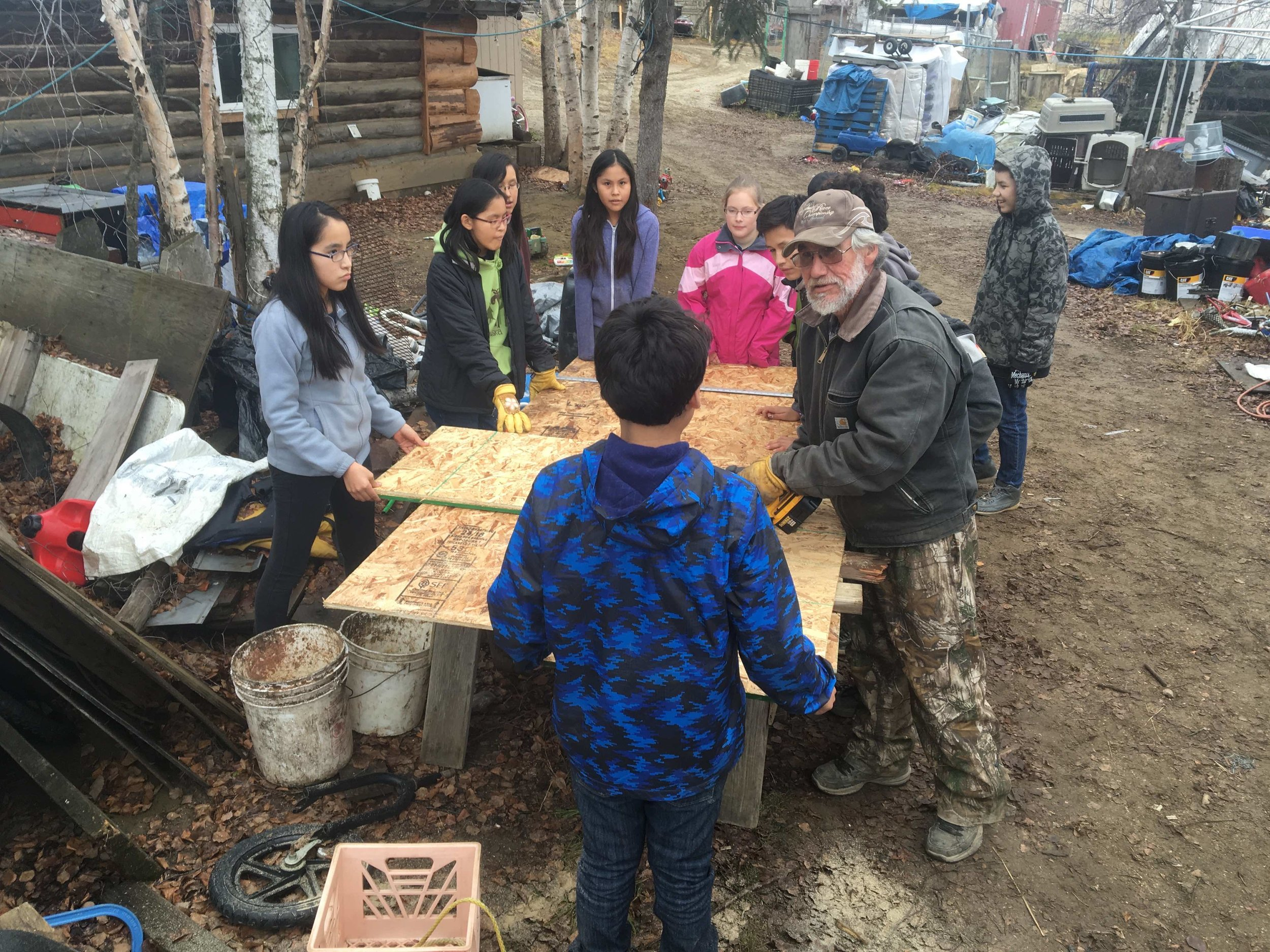 JHS middle school students building a dog house with Dog Musher Teacher Floyd Vent, Sr. Photo by Mickey Kenny.