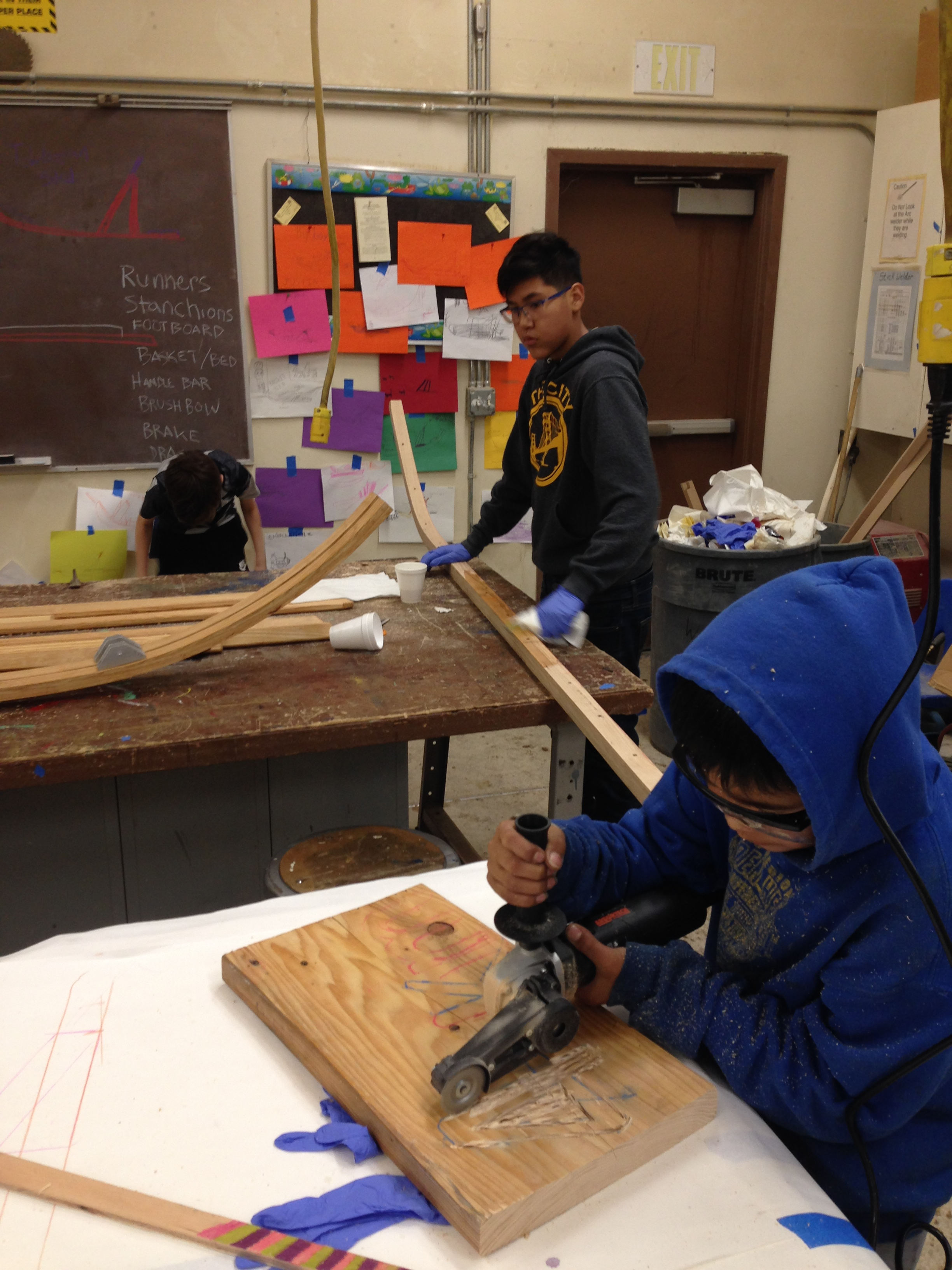 Students prepping sled runners.