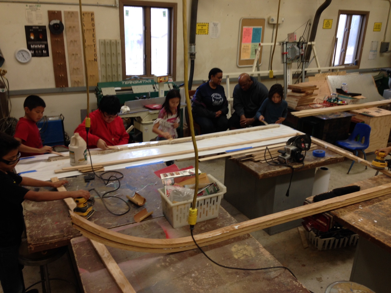 Students work with plastic for sled .