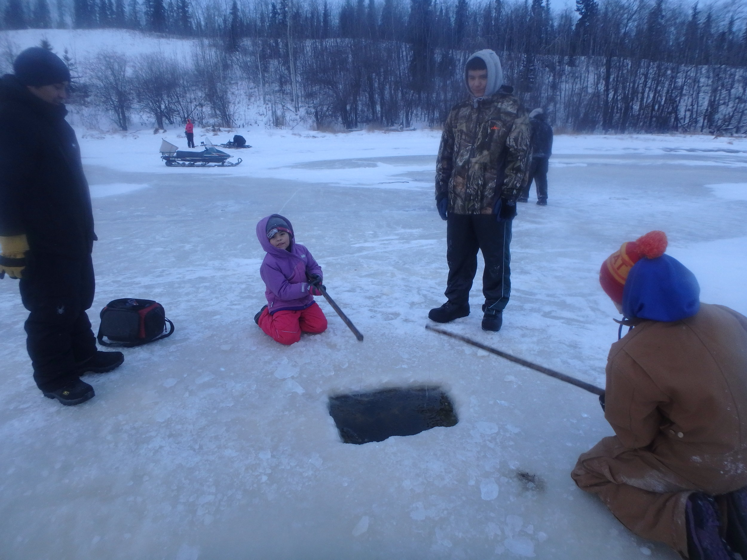 Students learned to use a hand auger to drill holes, the art of using a lure to catch fish under the ice and how to start, and keep a fire to be sure everyone kept warm.