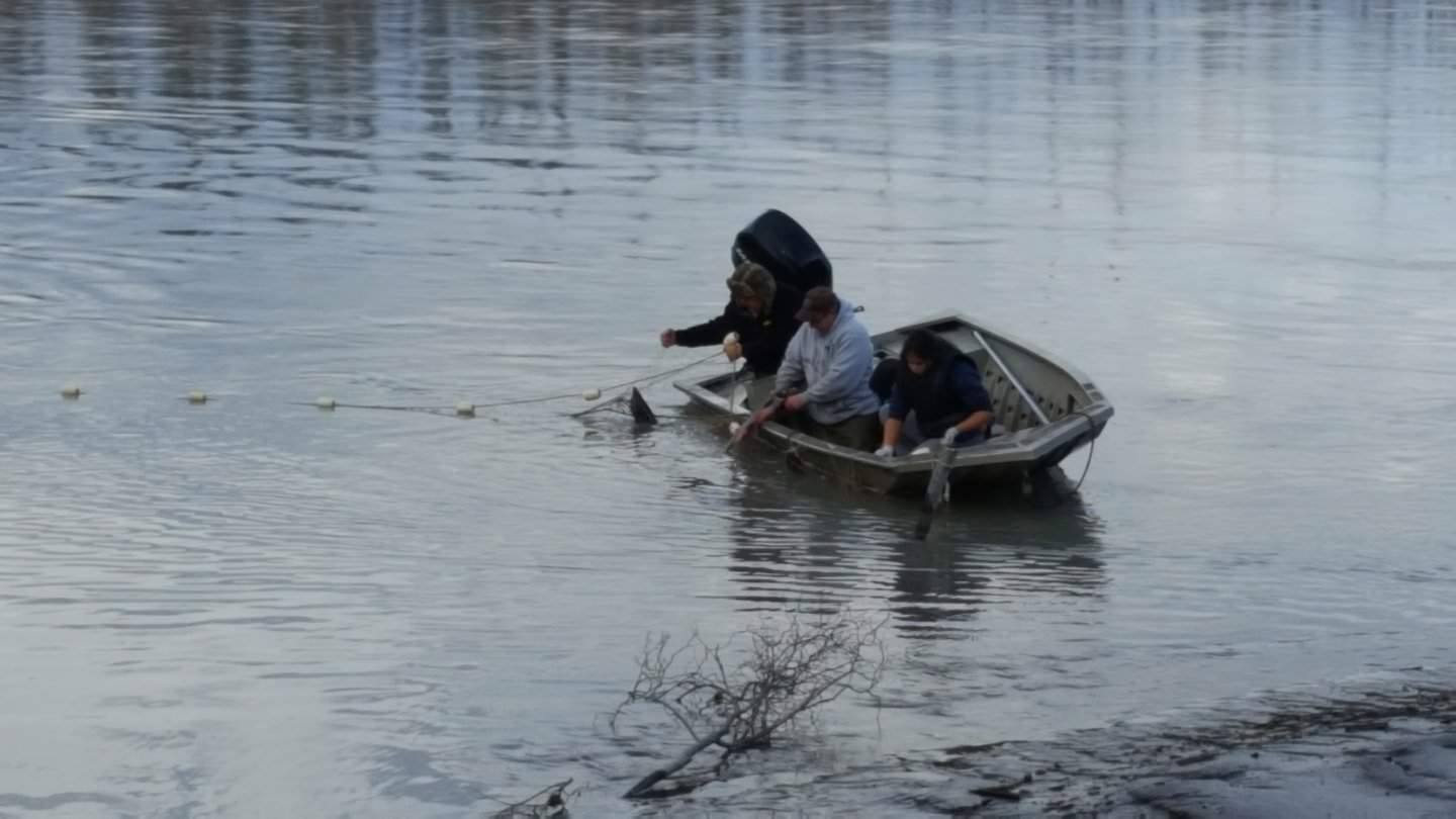 Students in boat catching salmon in Tanacross.