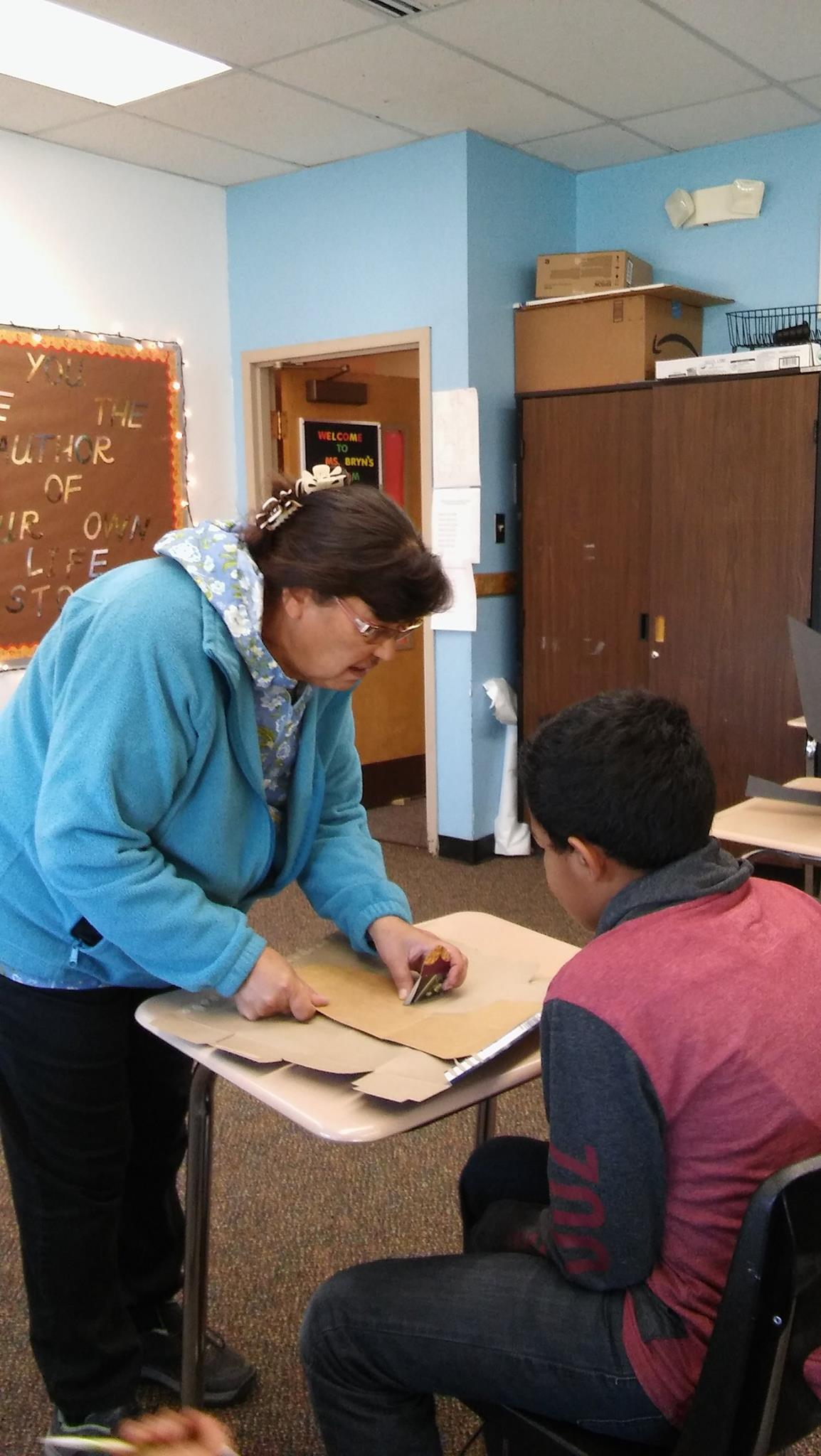 Local Culture Expert teaching students learn how to work with moose hide