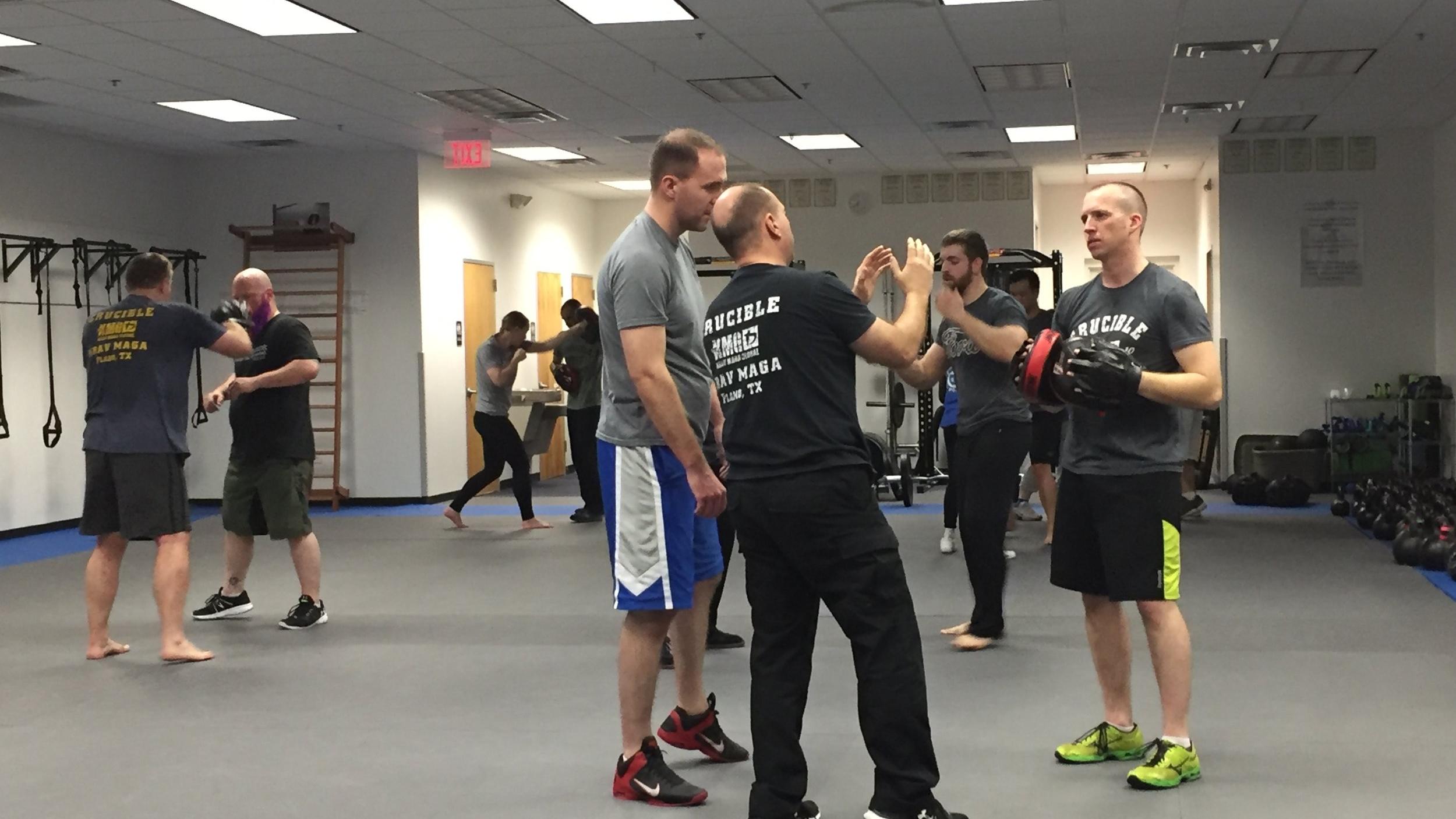 Mike Kawa teaching striking technique.