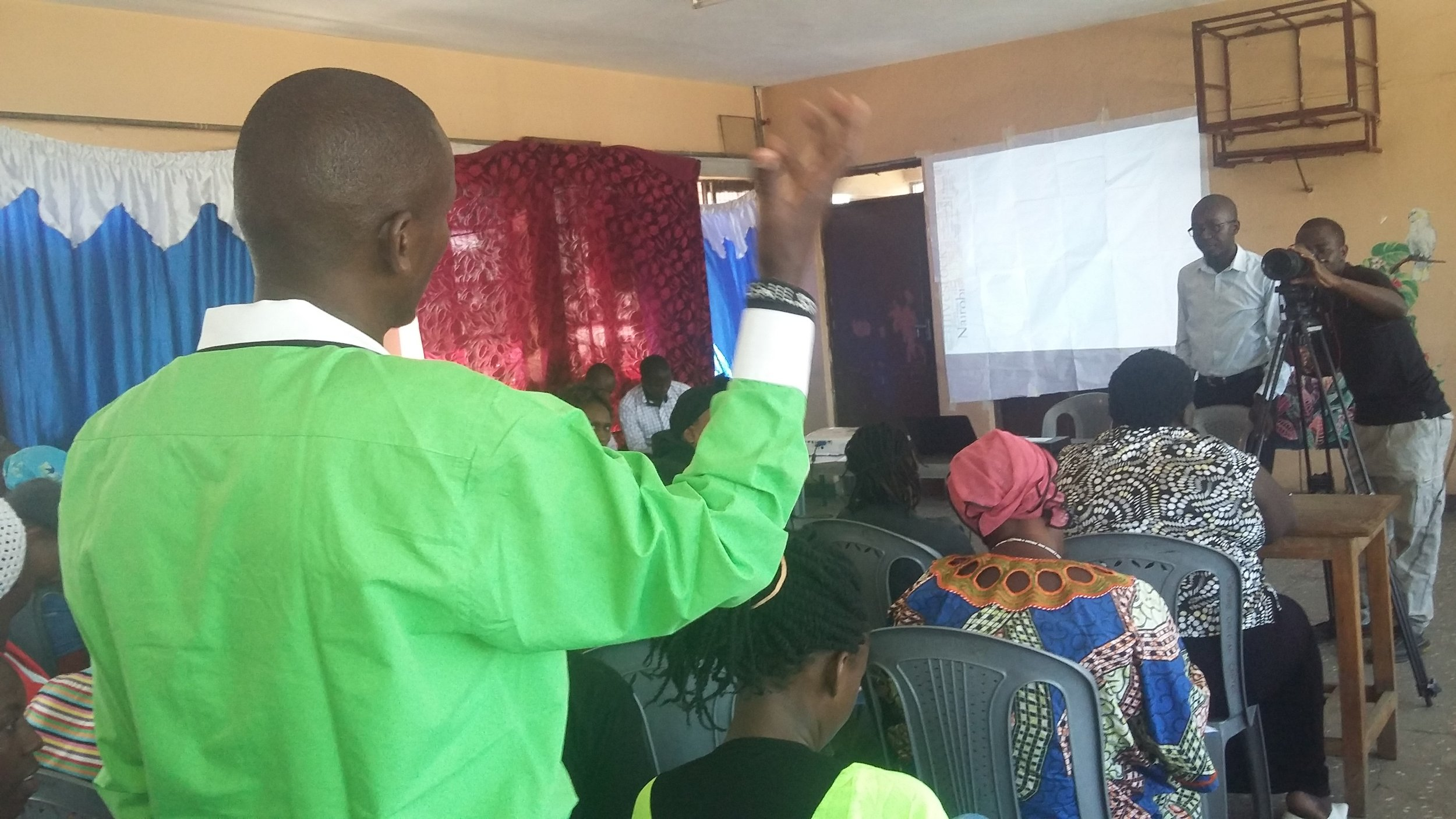 Willy Maina, one of the food security and safety coordinator makes a point during the training