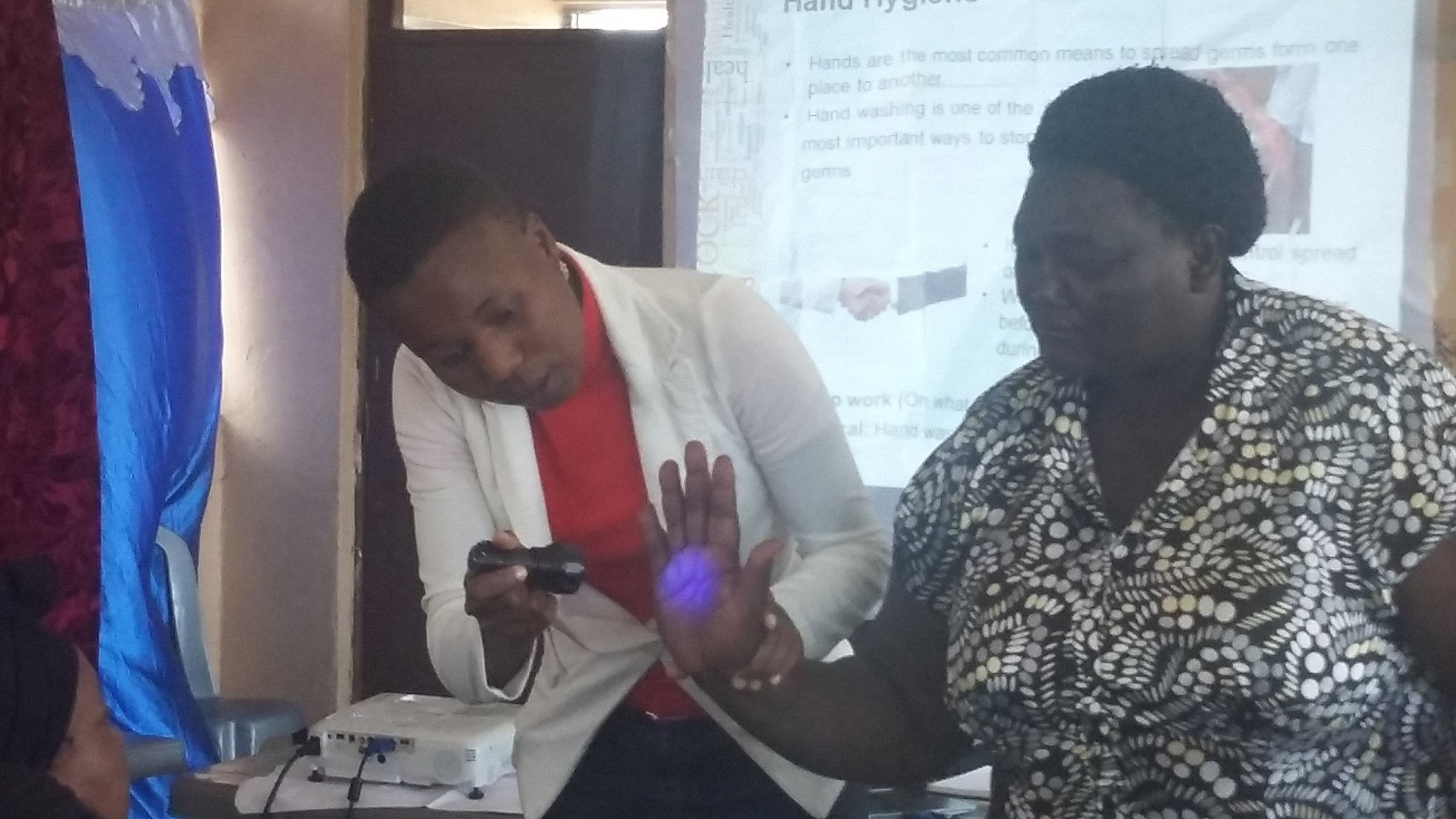 Lorraine of ILRI takes participants through hand washing procedure
