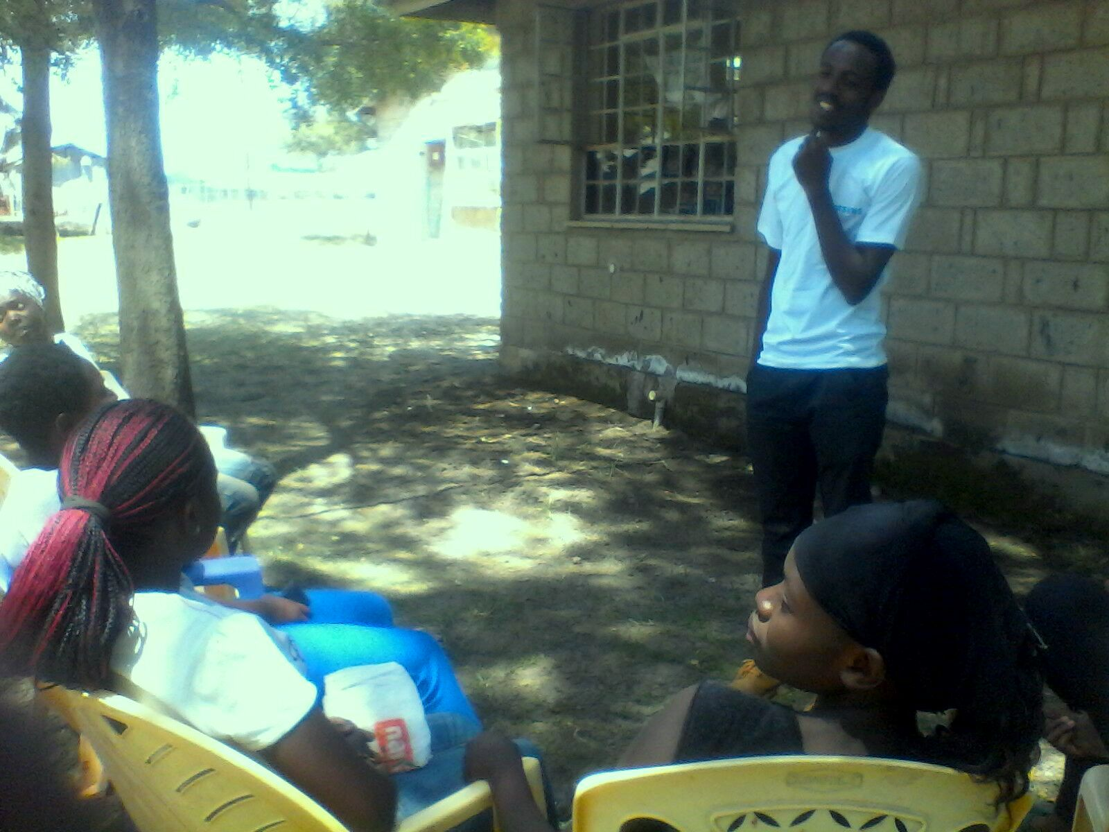 Kevin Kinuthia, engaging some of the young people from Mukuru slums during the Muungano Youth Engagement Forum