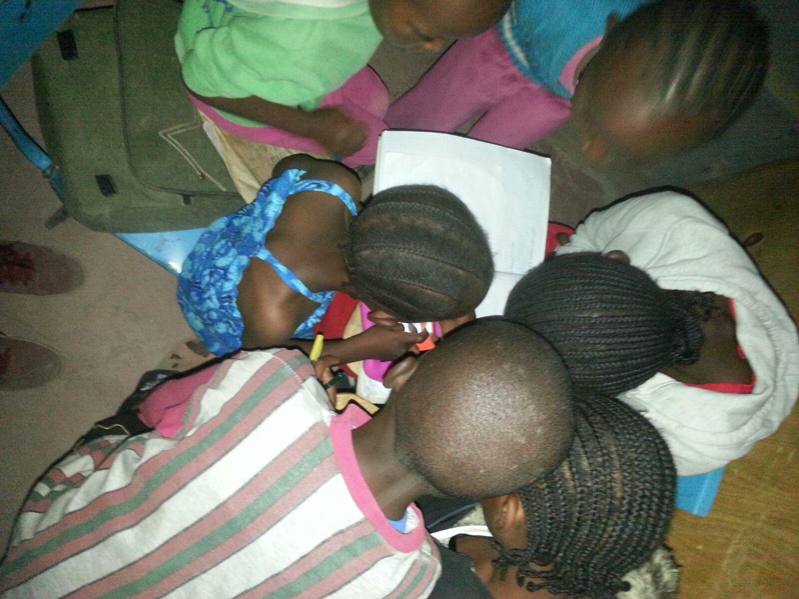 Children doing their homework at the Kambi Moto Community Library