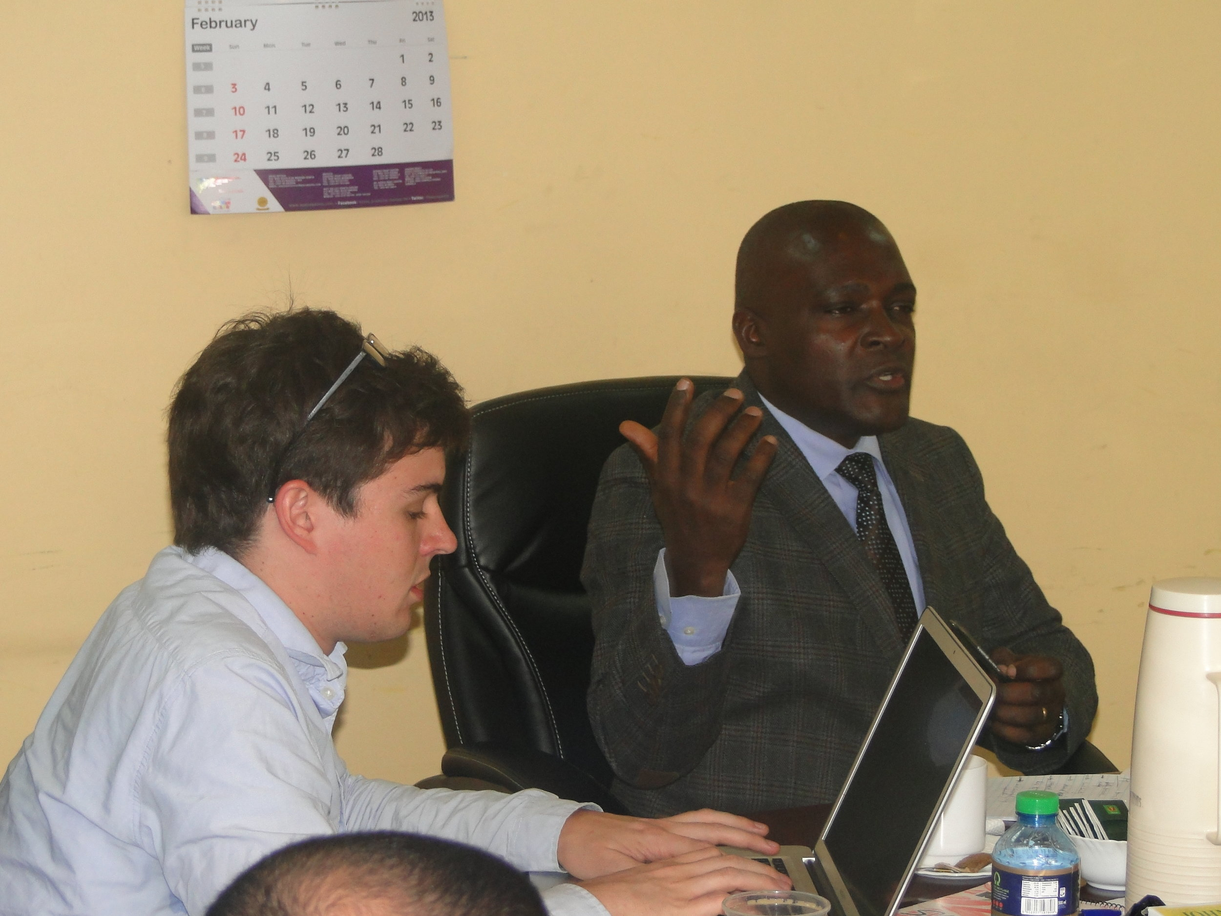 Director of Slum Upgrading, Charles Sikuku having a word with UCB Berkeley team on KENSUP