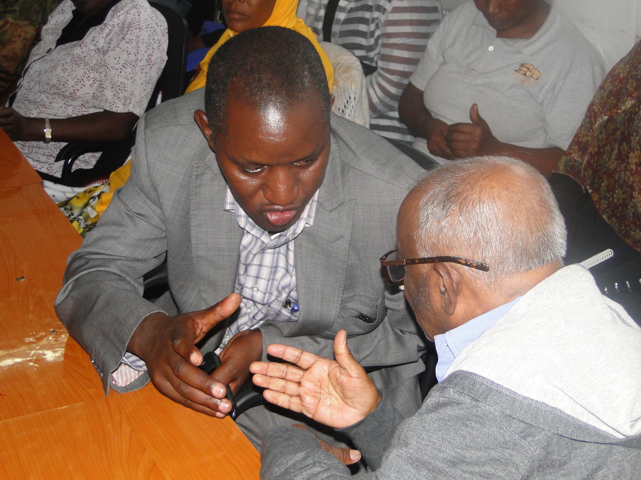 Naivasha MP. John Kihagi compare notes with Dr. Jockin.