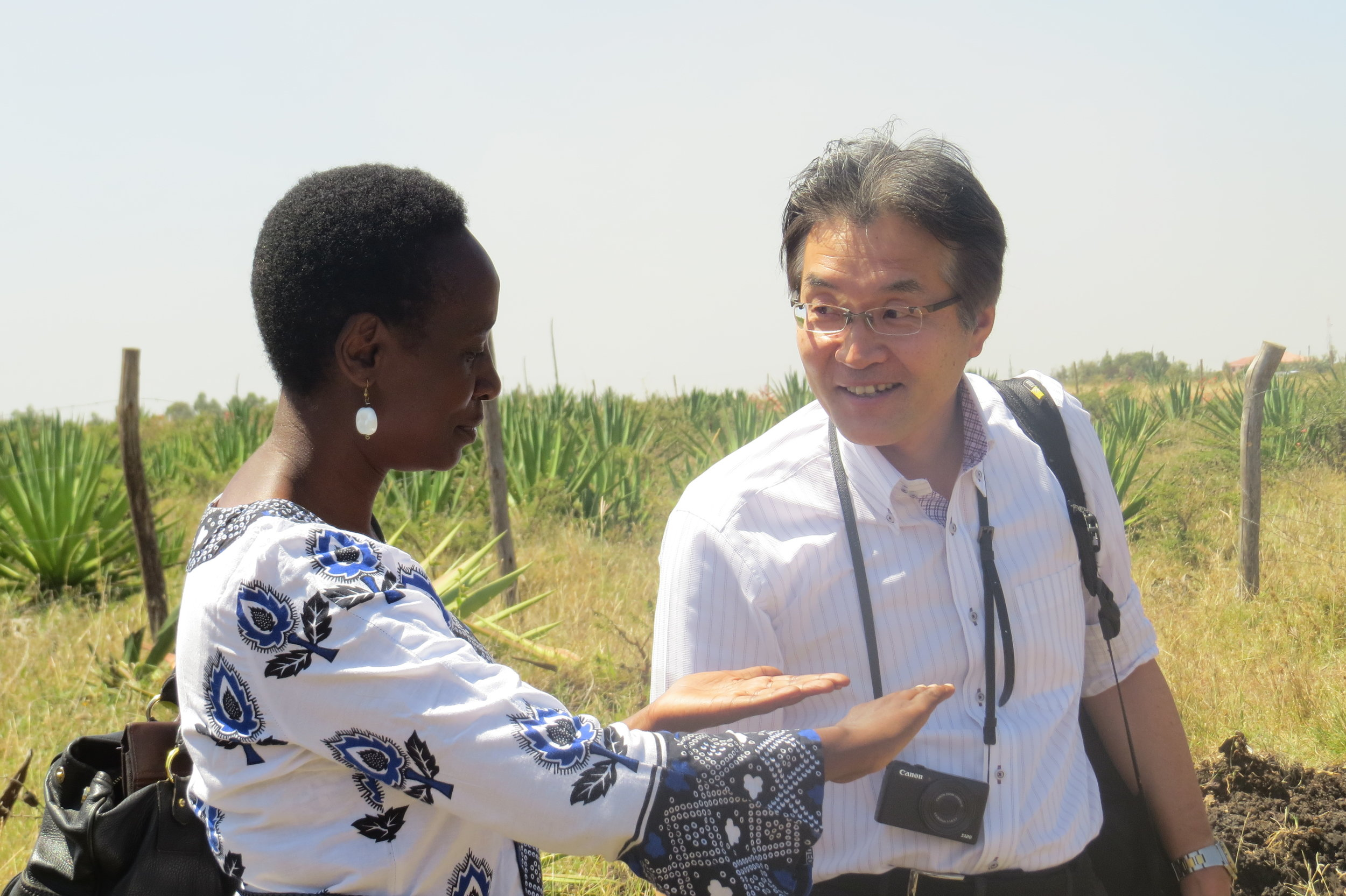 Jane Weru shares a light moment with one of the Lixil reprsentatives