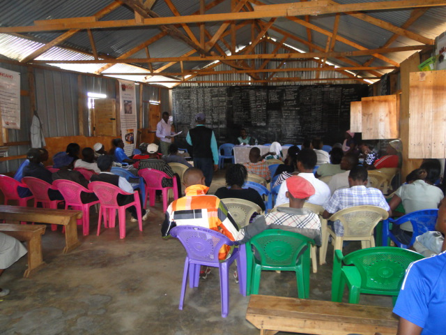 A meeting in Progress at the Kiandutu Community social Hall
