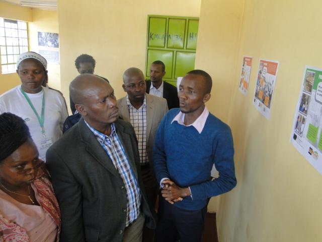 Governor William Kabogo is taken through the Profiling and Mapping methodology by Killion Nyambuga a technical support officer with Muungano wa Wanavijiji.