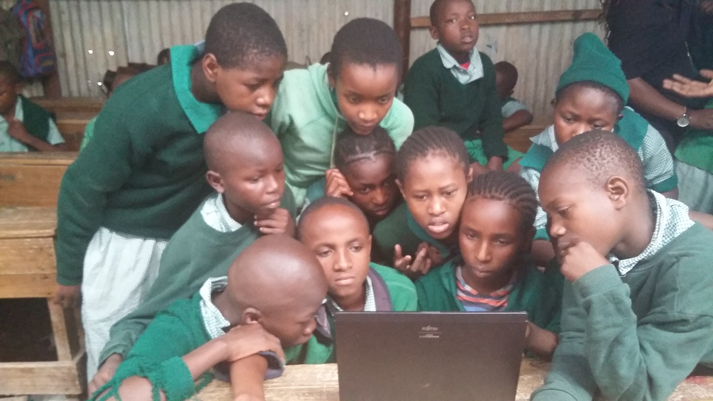 Kids from Church on the rock, Mukuru enjoying their group computer classes.