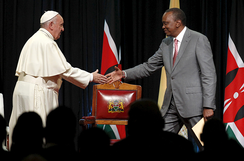 Pope Francis greets his host Kenya's President Uhuru Kenyatta after he delivered his speech during a reception at the State House in Kenya's capital Nairobi, on November 25, 2015. Photo courtesy of REUTERS/Thomas Mukoya *Editors: This photo may only be republished with RNS-POPE-AFRICA, originally transmitted on Nov. 25, 2015.