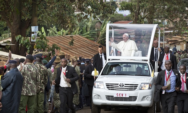 The Pope heading to the St. Joseph the Worker Catholic Church in Kangemi of Friday . Picture Courtesy of Ben Curtis/AP