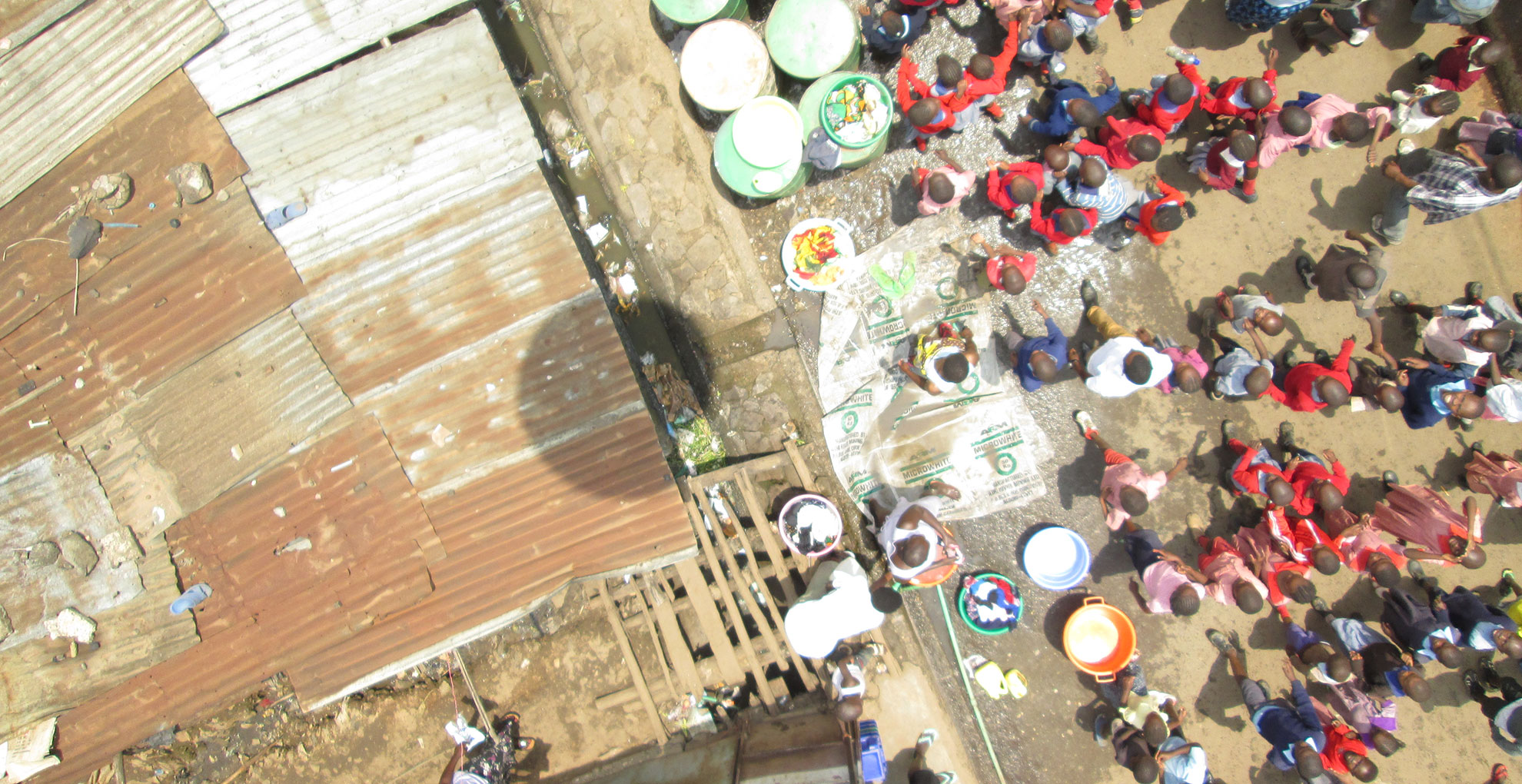 Kids following the aerial mapping process in Mathare.