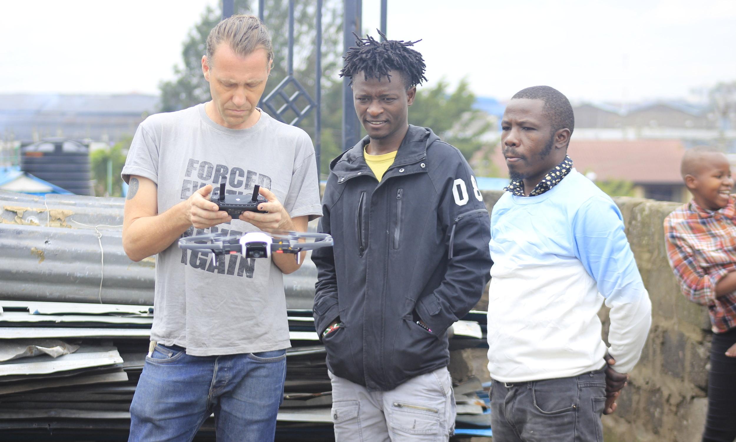 Muungano's KYC.TV team receives practical lessons on using drones in filming from KYC.TV program facilitator James Tayler, in Mukuru, Nairobi.