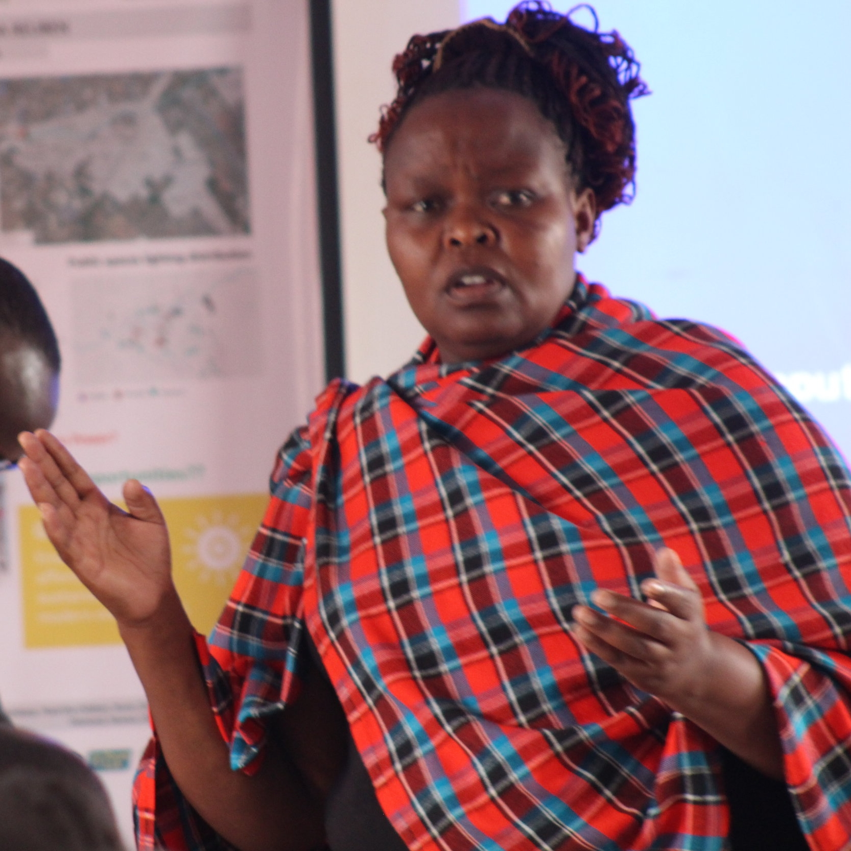 Felista Ndunge, one of Muungano's Mukuru SPA community mobilizers, at one of the August pre-consultation meetings of the Mukuru SPA Water, Sanitation and Energy consortium..
