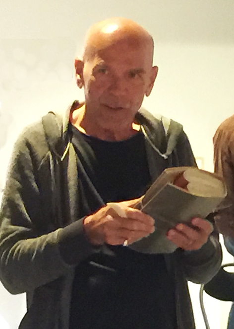 Dr Clyde McGill  playing one of his amplified performance books live at abe 2017