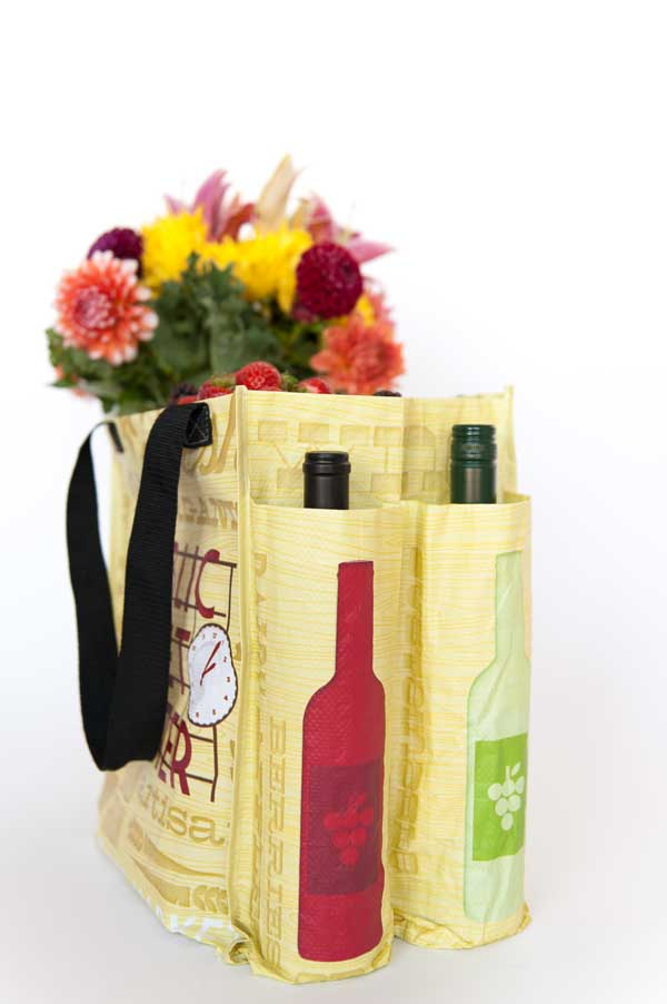 Pike Place Market Tote side view with wine bottles and flowers