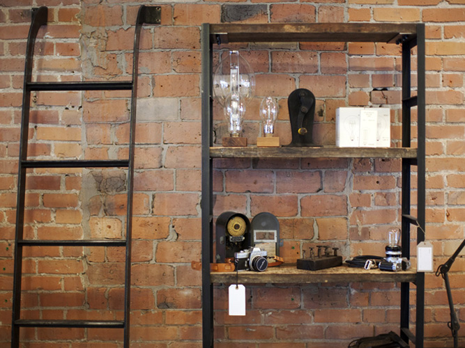 Brackish Designs Wooden Shelving Unit and Ladder In Glasswing Store
