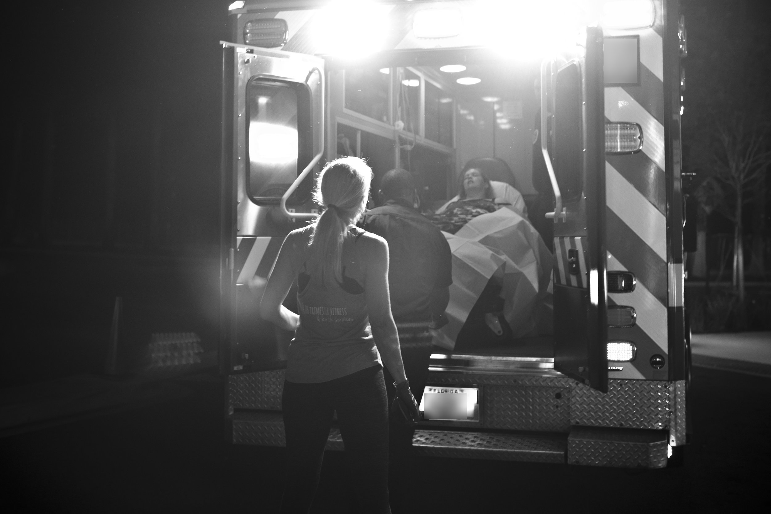 Doula watches her birth client exit an ambulance as they arrive at the UF Birth Center in Jacksonville, Florida. Mom went on to have a peaceful water birth.